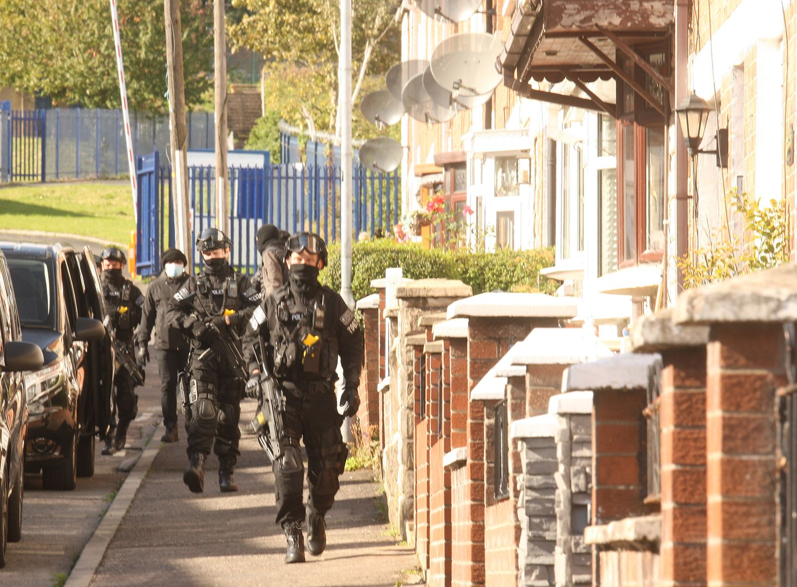 CAMERA, ACTION: Our photographer Thomas McMullan was on hand as this scene in Line of Duty developed in Beechmount on Monday