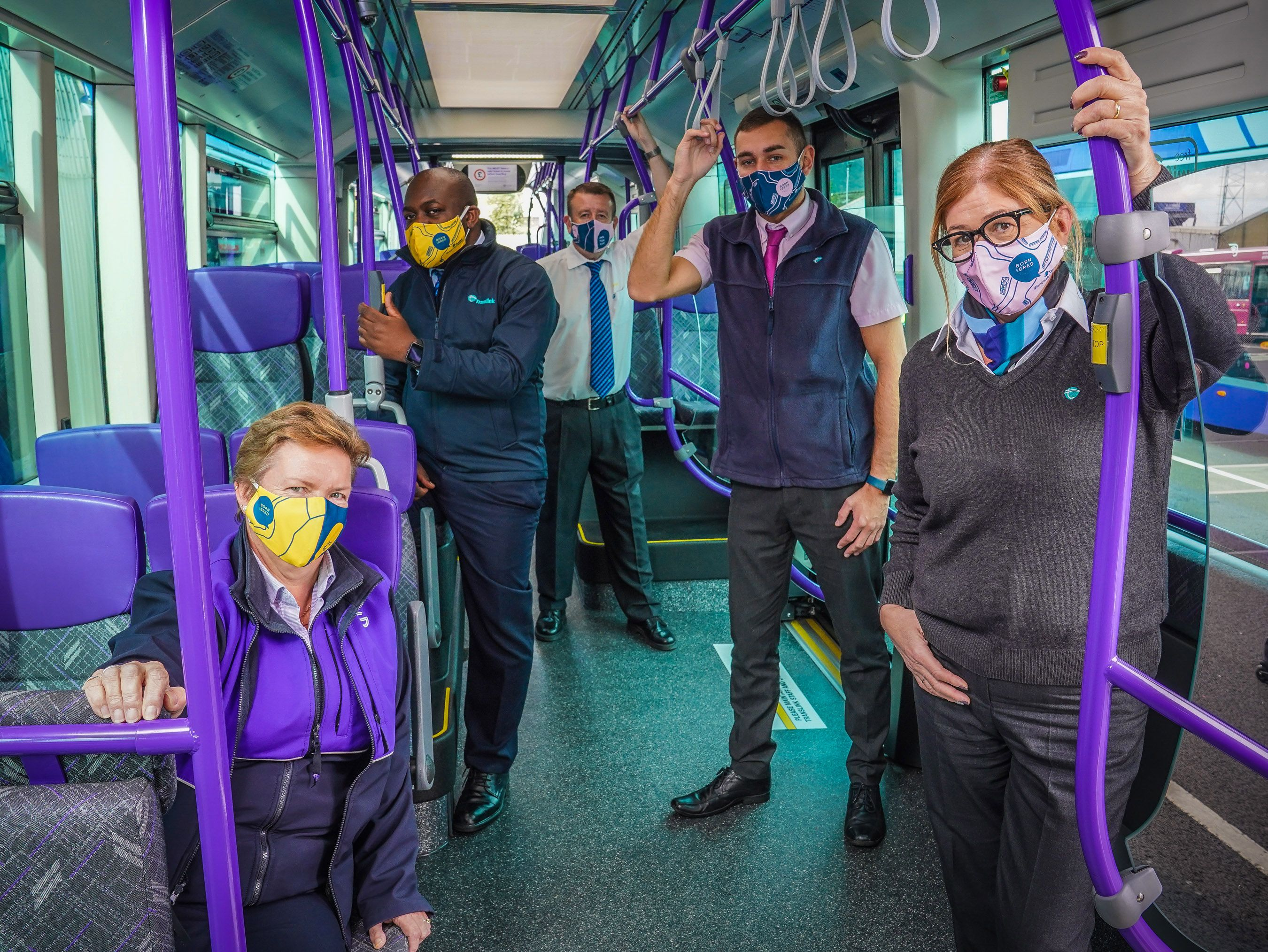 KEEPING EACH OTHER SAFE:Launching the limited-edition giveaway of bespoke face coverings are Translink staff Karen Spence, Kaz M'wepu, David Sewell, Ruairi Smith and Alice Kitchen