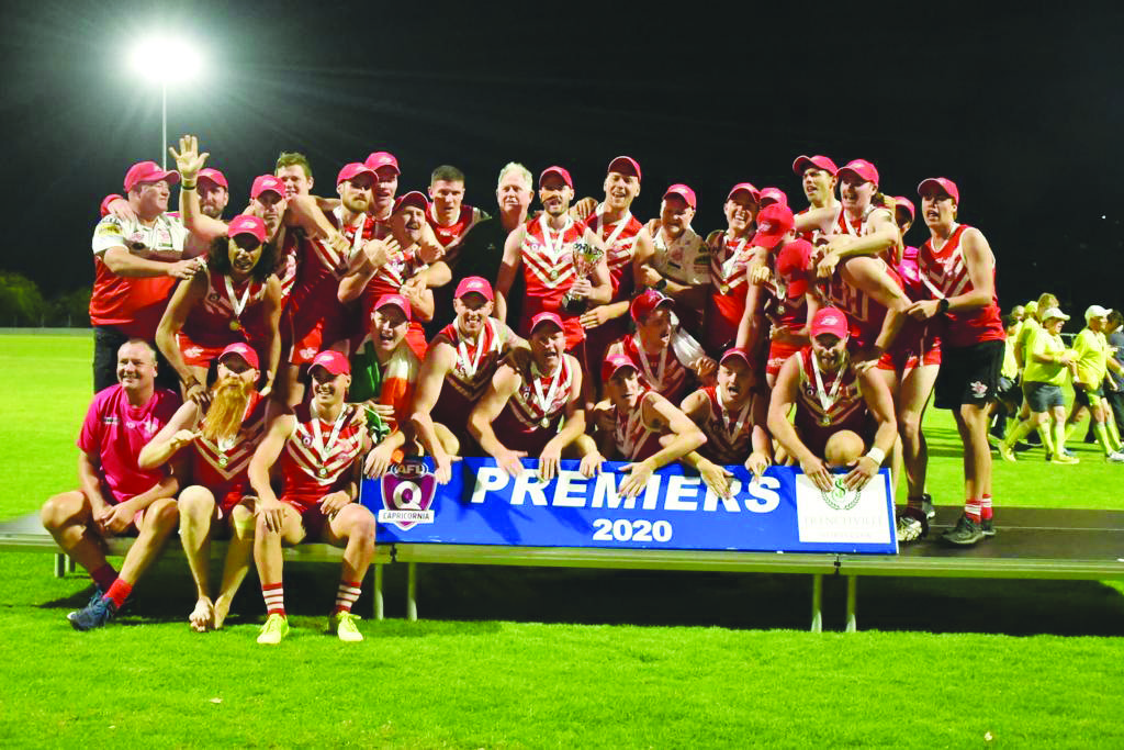 Yeppoon Swans celebrate after their sixth-straight Premiership win that also saw them break an Australian Rules record by winning their 89th-straight game