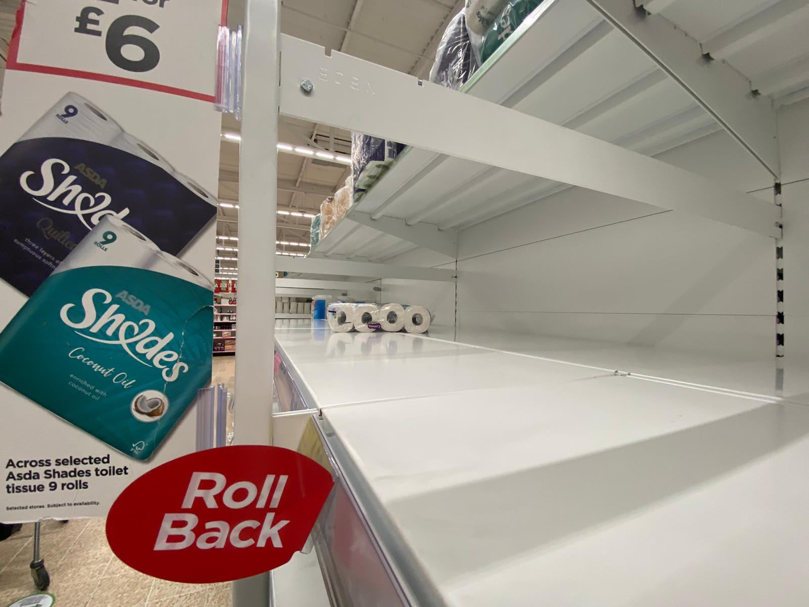 GONE: Shelves stripped again as panicking shoppers react to new restrictions