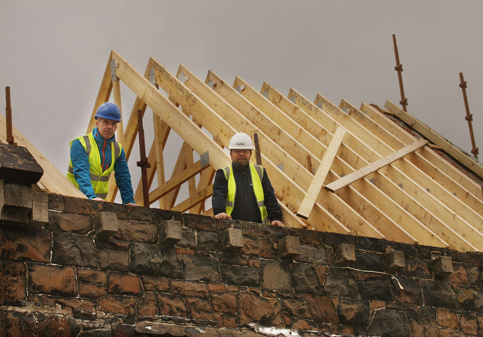 ON TOP OF THE WORLD: Councillor Stevie Corr with contractor Dessie Brennan