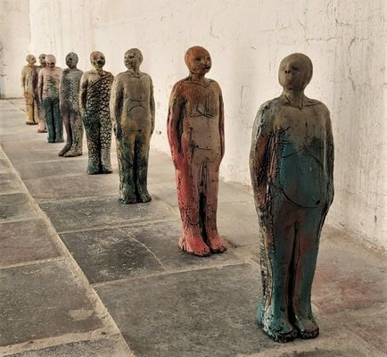 Cropped queue   8 stoneware figures measuring 30cm high  whole piece is 2.4m in length  6