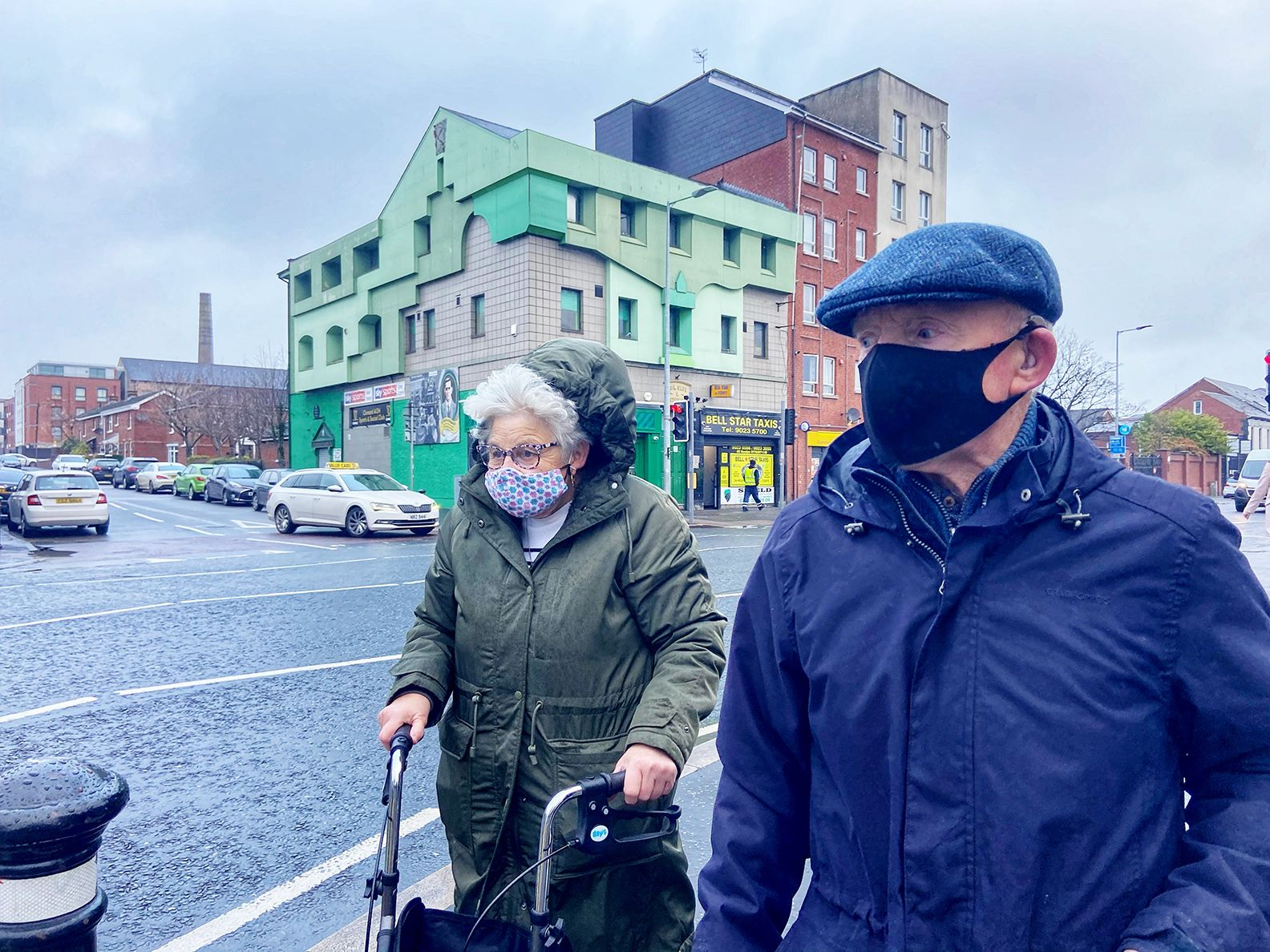 HEALTH THE PRIORITY: A masked couple on the Falls Road at Clonard which is now the second-worst Covid-hit postcode in the North.