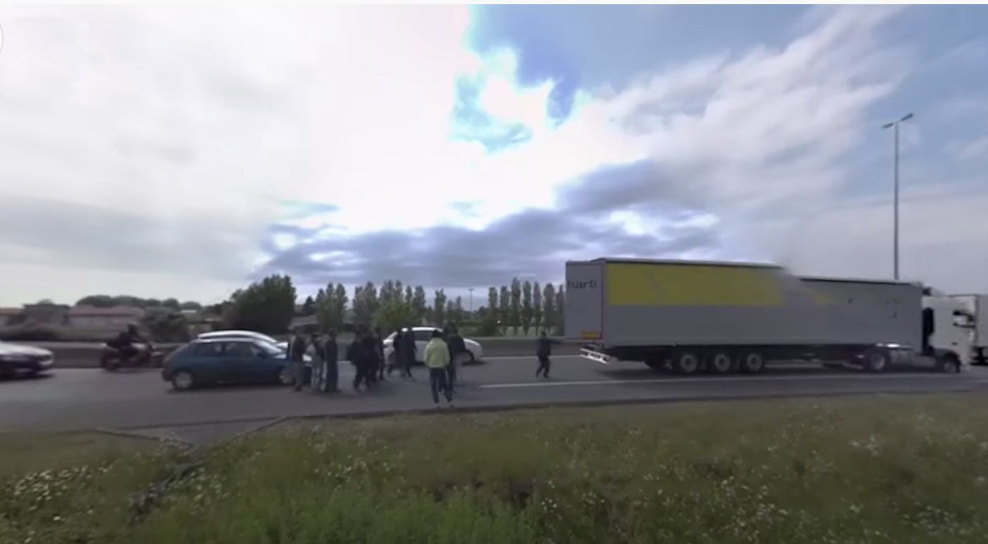 DESPERATION: Migrants attempt to board a truck at the French port of Calais