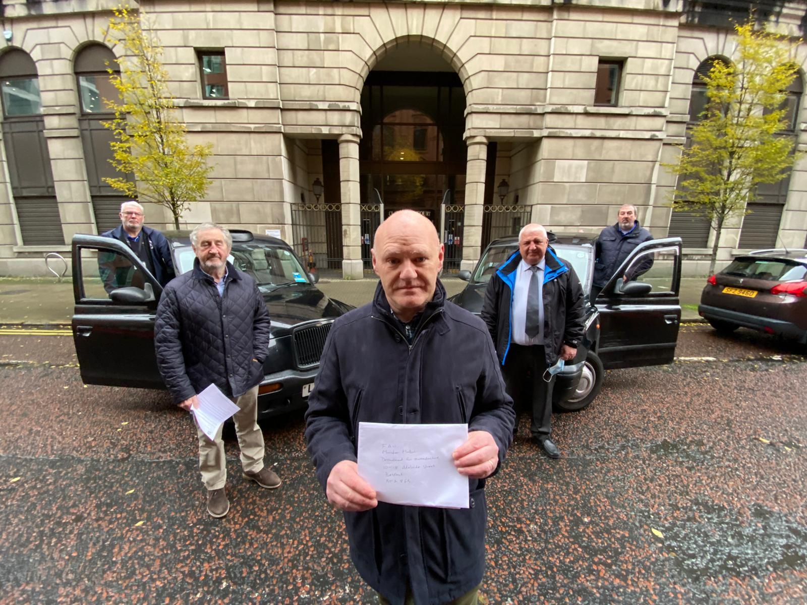 CONCERN: West Belfast MP Paul Maskey joins black taxi drivers handing over their request for a meeting with the minister