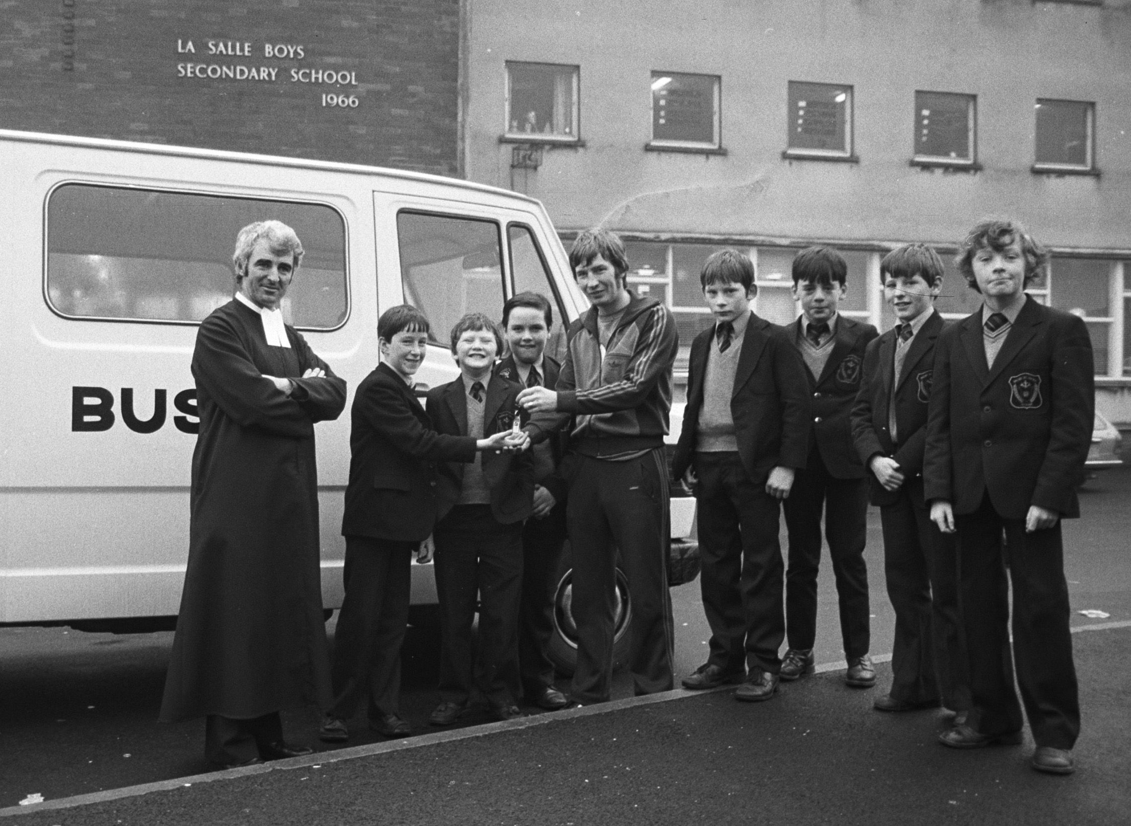 NEW KEYS: Brother Dominic, principal of La Salle, with Sean McGourty, pupils and the new school minibus, which was bought after money was raised  following a sponsored walk by staff and pupils to the Mary Peter's Track back in September