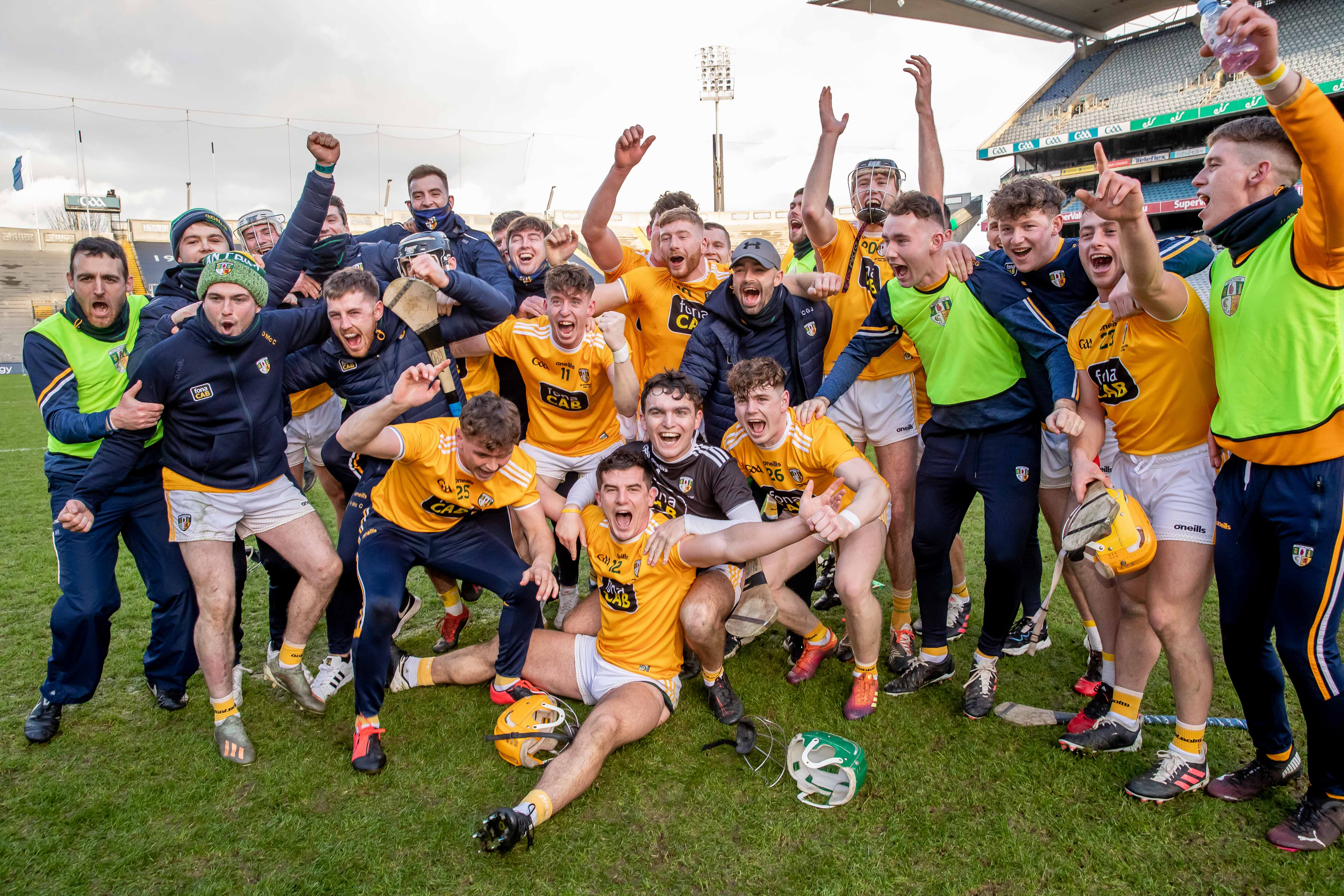 Antrim players celebrate their triumph over Kerry on Sunday afternoon