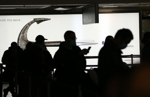 TRAVEL BAN: Passengers wearing face masks in Dublin Airport yesterday.