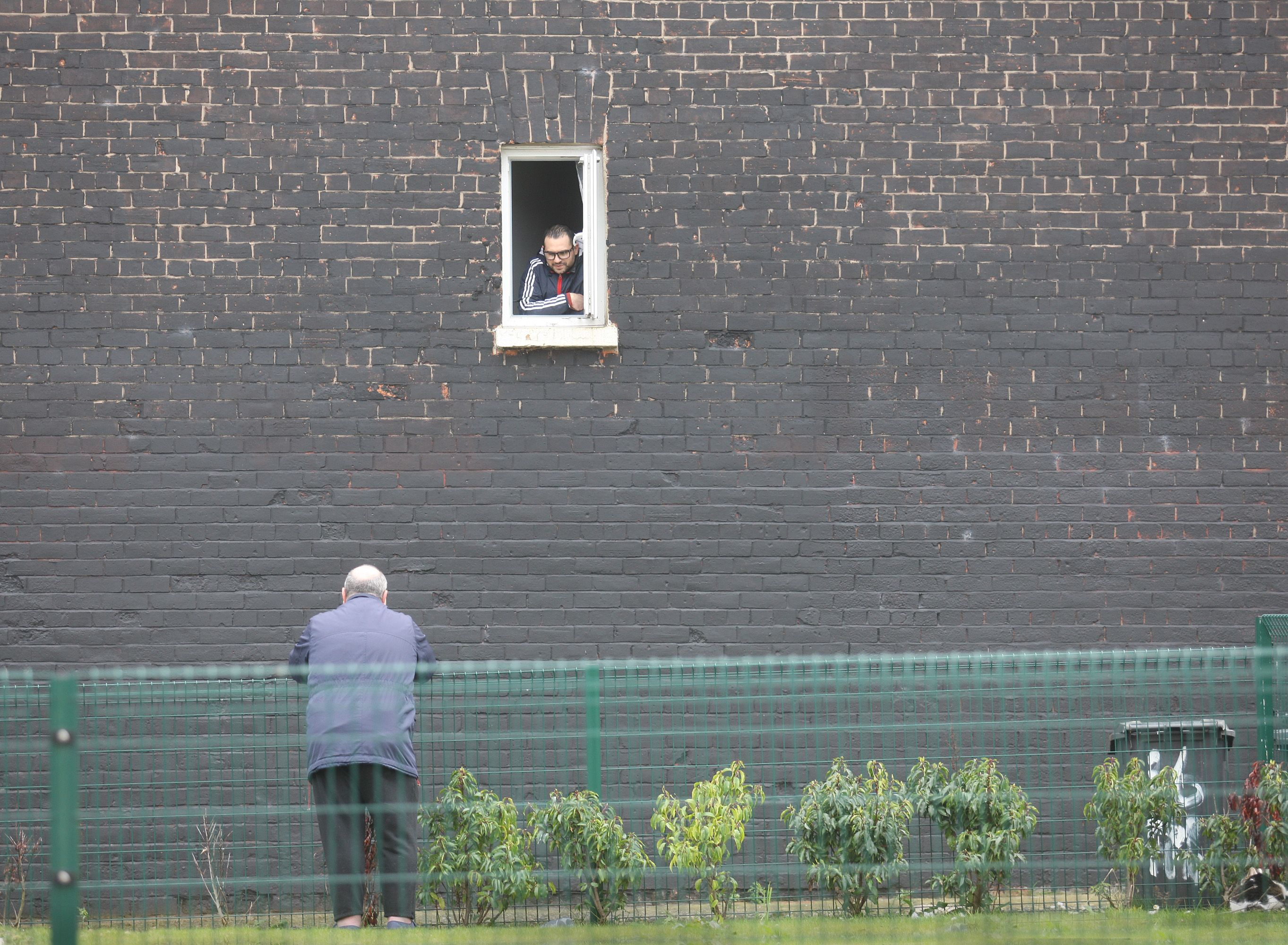 FROM A DISTANCE: Two chums chat during the spring Covid surge