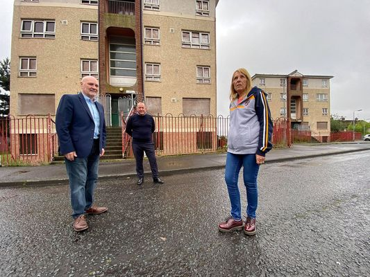 END OF AN ERA:Sinn Féin Cllr Arder Carson and Alex Maskey MLA with Ann Marie Weir from the Upper Lenadoon Residents' Association at Corrib Flats near the Shaws Road
