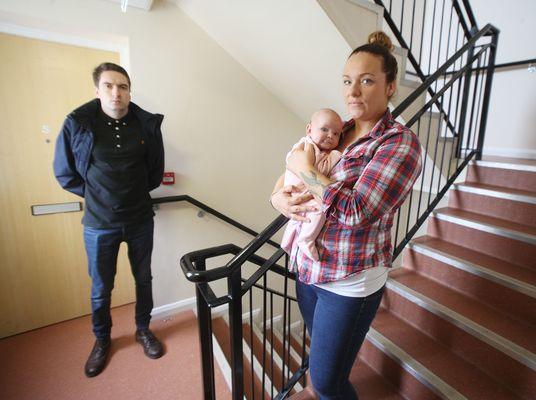 WORRIES: Lauren Scullion, with her new-born baby, explains her dire situation to Matt Collins MLA