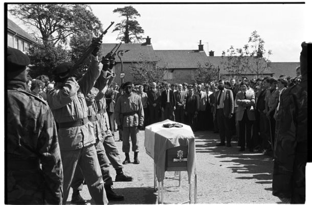 SALUTE: IRA volunteers fire a volley of shots over the coffin of hunger striker Kieran Doherty TD outside his Commedagh Drive home