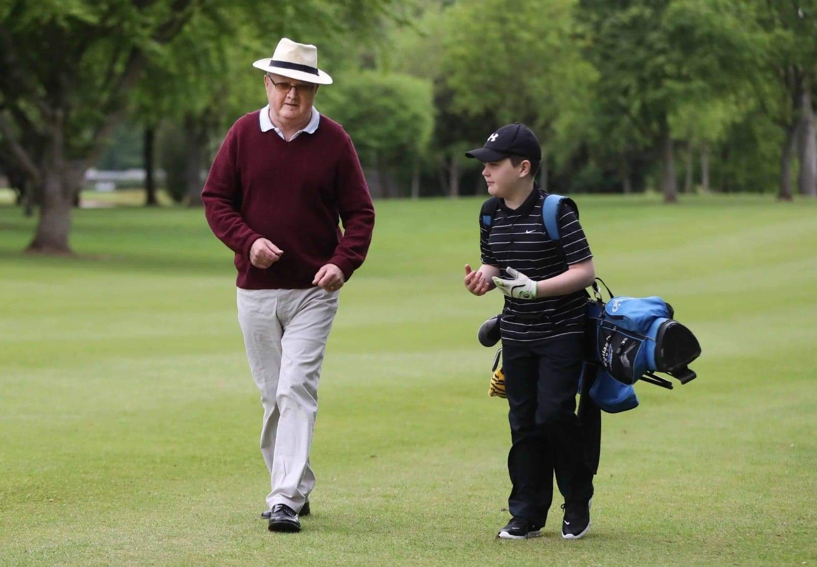 DREAM ROUND: Aaron O'Reilly and his granddad Kevin on the fairway at Dunmurry Golf Club