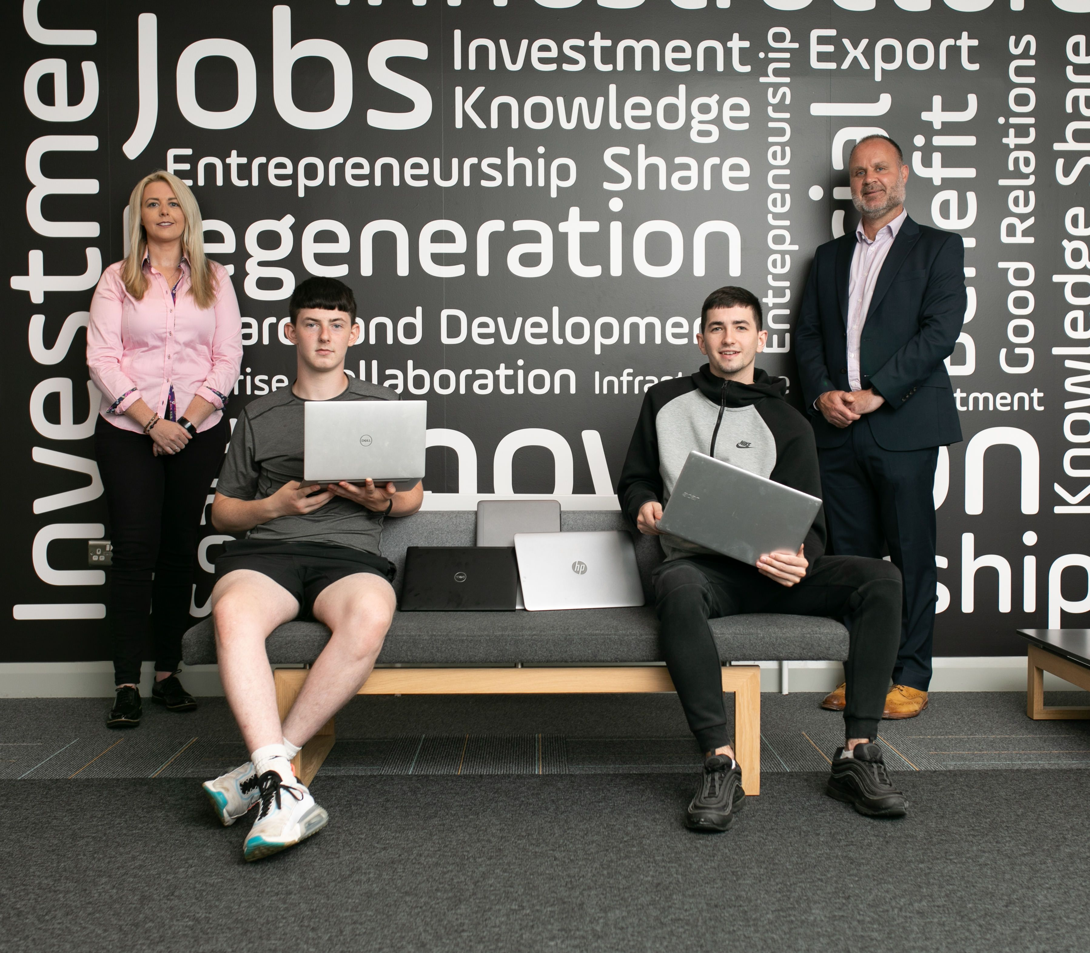 Graffiti Recruitment Managing Director Julie McGrath with Innovation Factory Community Engagement Manager Shane Smith and two of the digital champions, Joseph McKeating (front left) and Eamonn Marley (front right)