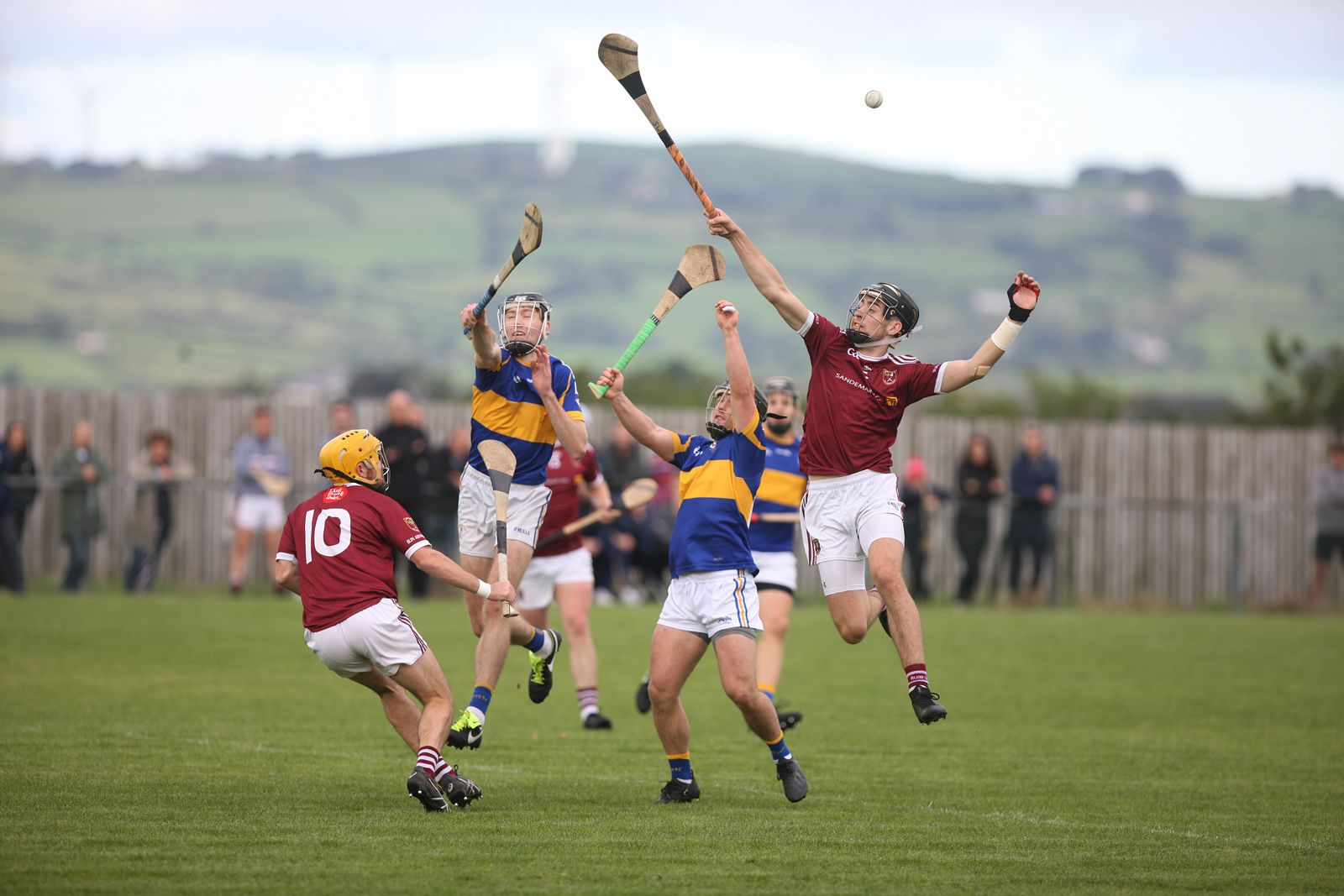 Rossa and Cushendall players contest a high ball during Saturday\'s quarter-final