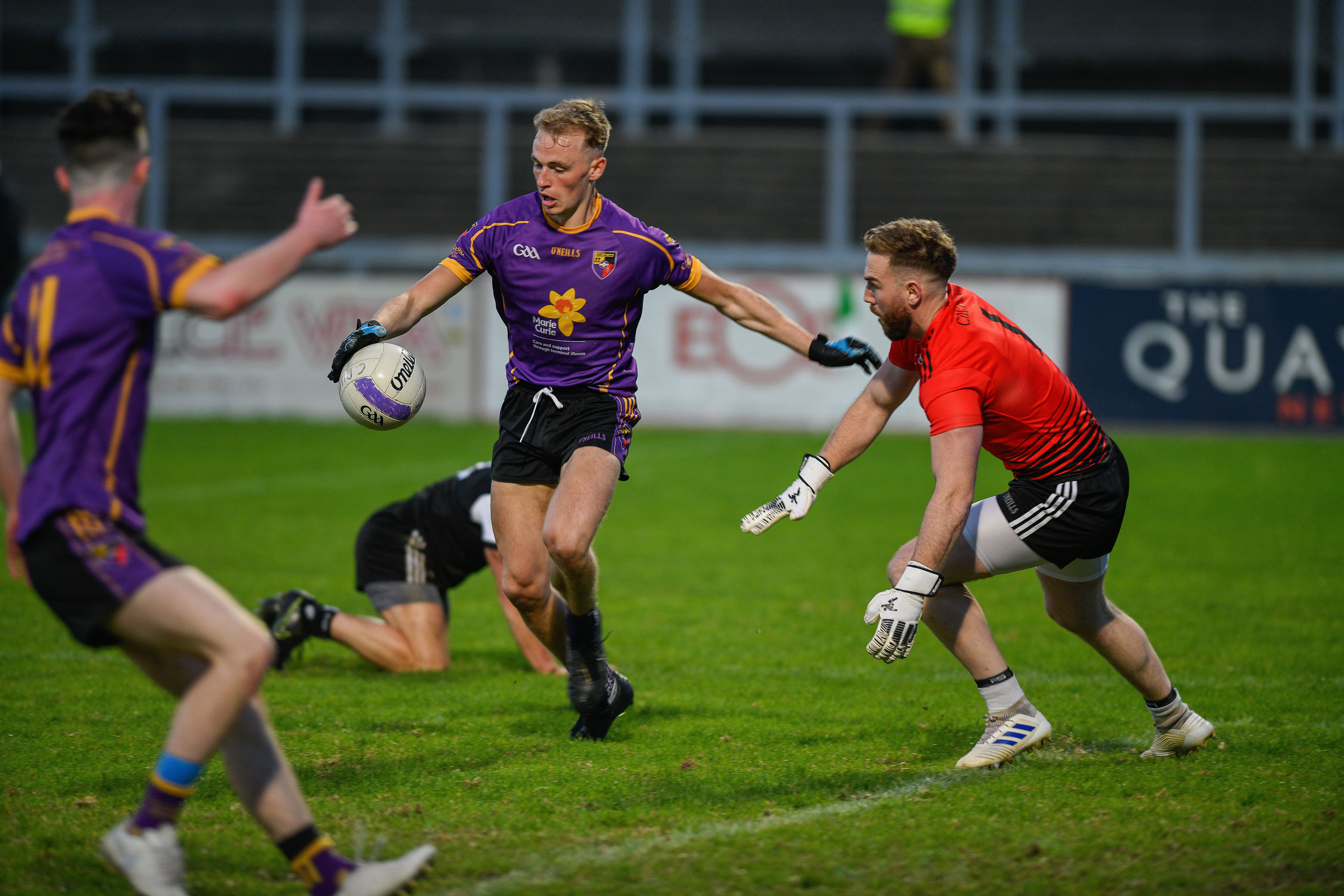 Ronan Beatty rounds Kilcoo goalkeeper Niall Kane late in the first half, but the Carryduff attacker couldn\'t keep his shot down and had to settle for a point