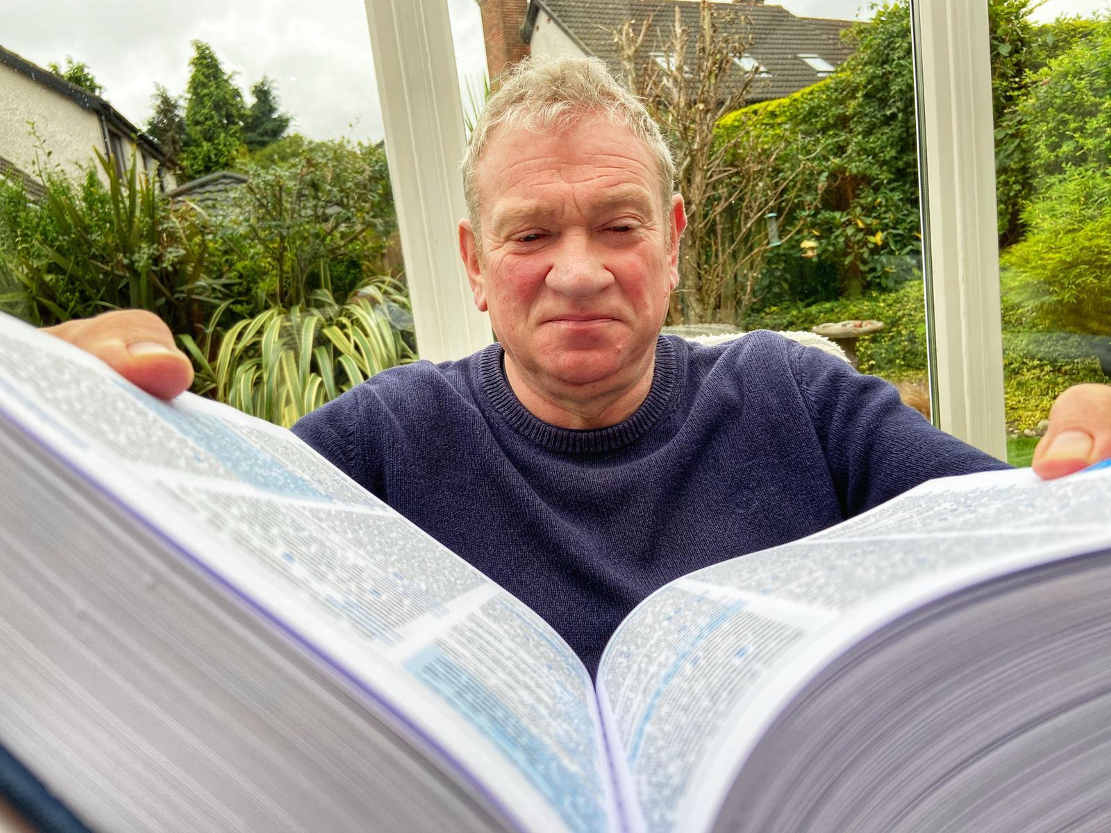AN FOCAL SCOIR: Lexicographer Pól Mac Fheilimidh scans the new ÓMianáin Dictionary