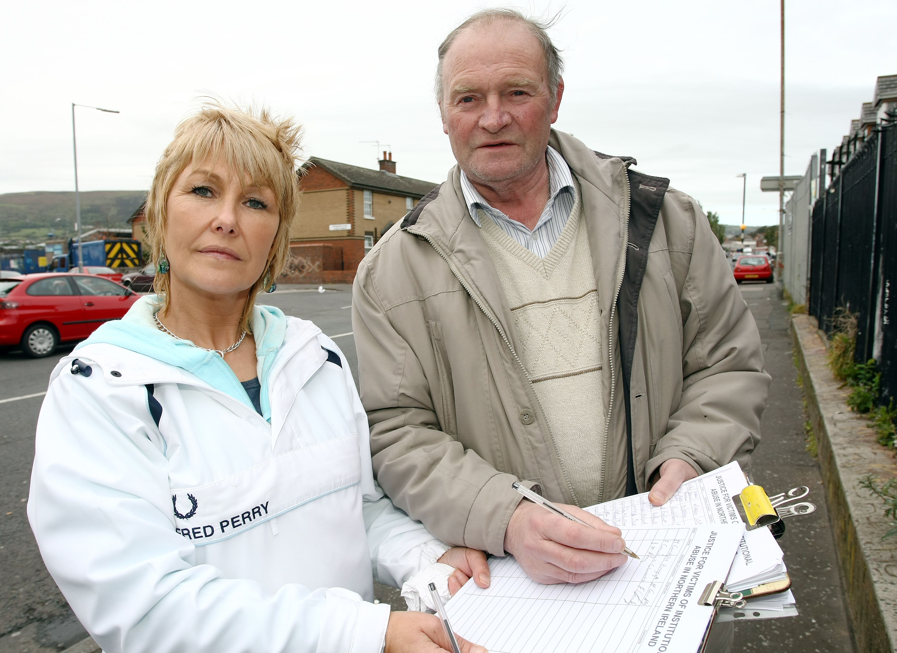 TIRELESS: Institutional abuse survivor Margaret McGuckin with Joe McCorry signing her petition; the appointment of a Commissioner has harmed the campaign