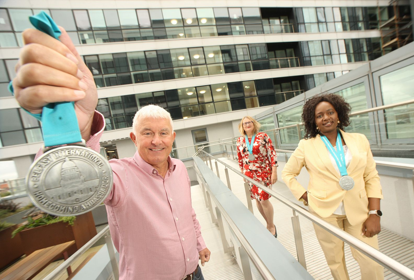 A RICHER NEIGHBOURHOOD: Brendan Monaghan, CEO of Homecoming business partners Neuda, with Belfast-based ambassadors Barbara Snowarska, a native of Poland, and Donna Nalongo Namukasa who hails from Uganda
