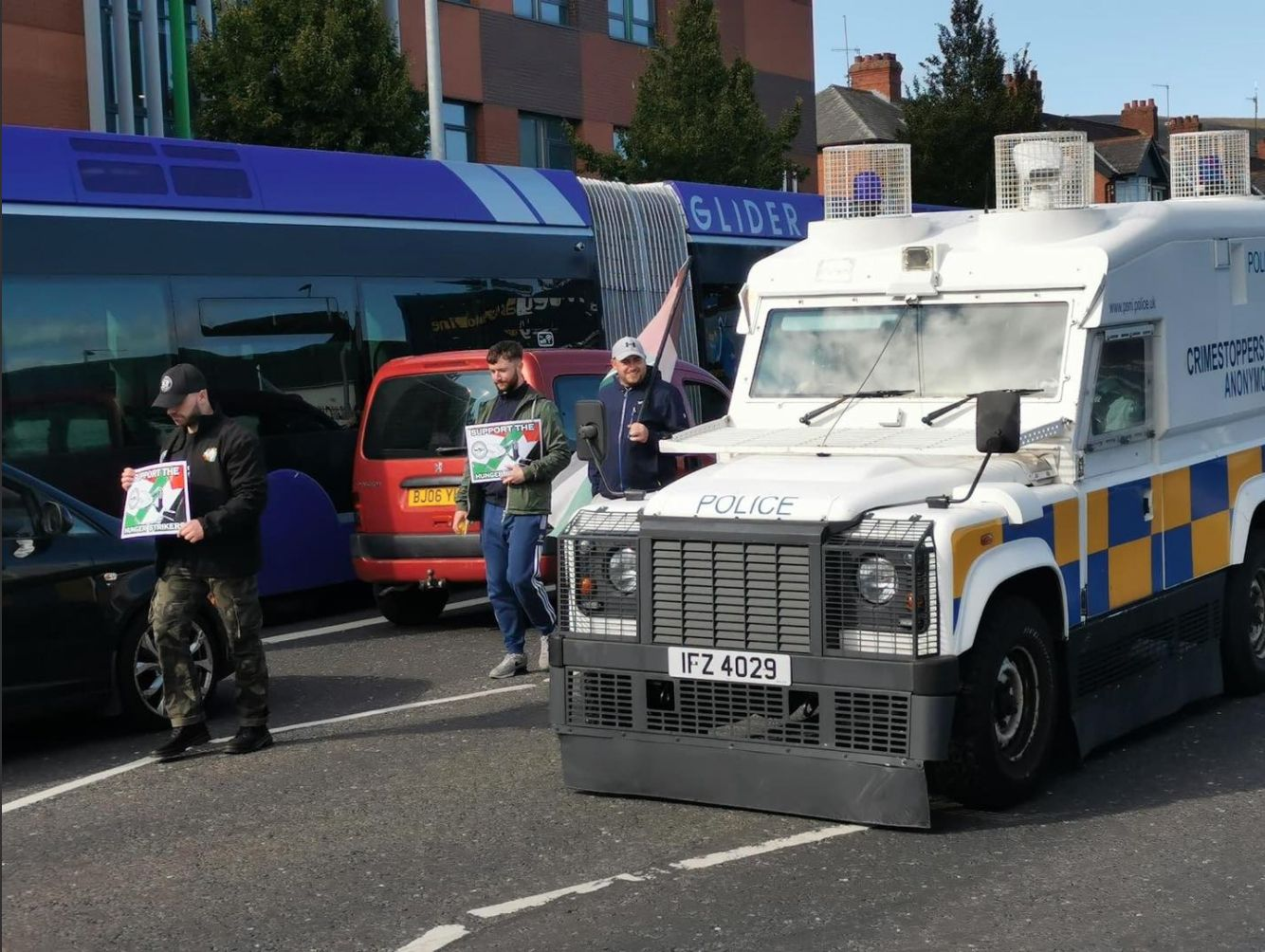 PROTEST: A PSNILand Rover passes a white line picket on the Falls Road in support of the hunger strike