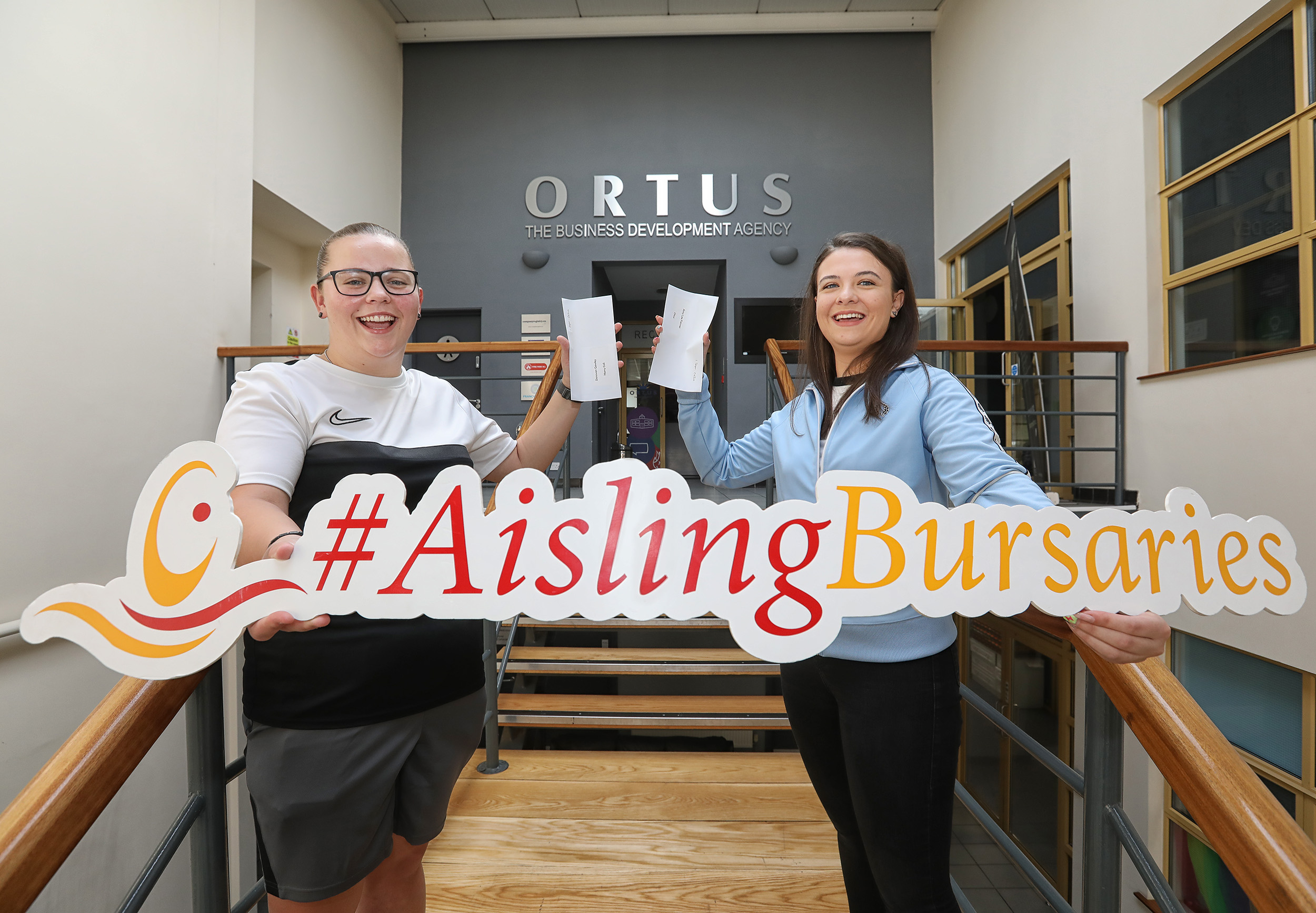 Donovan Gawley accepts the Ortus Bursary to help with her studies in a Certificate in Community Youth Studies at Ulster University. Amy-Lee Farmer, who is entering second year in Law LLB at Queen's University is delighted to accept the Harry Coll Memorial Bursary.