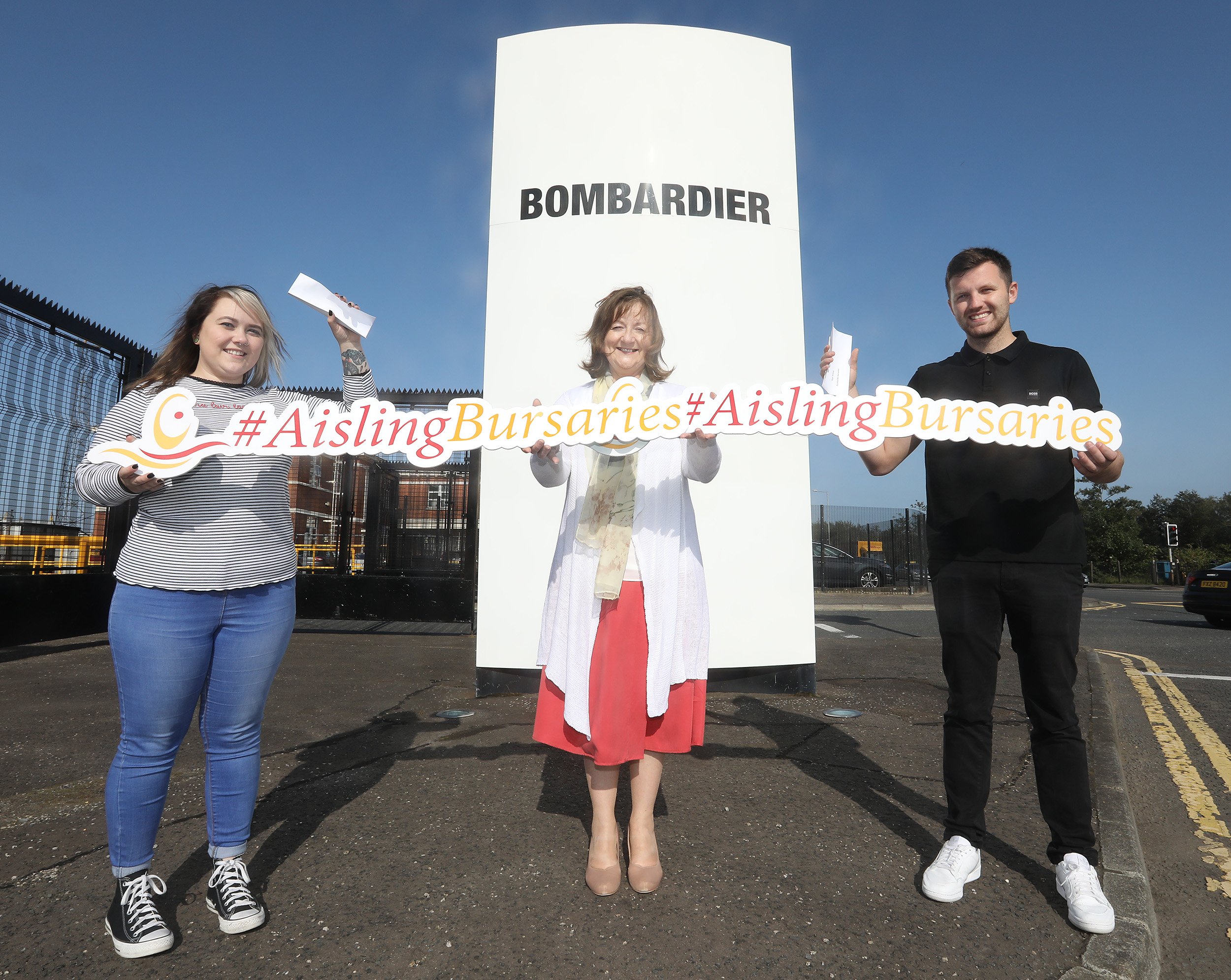 Carol Phillips, VP, Human Resources, Bombardier Aerostructures and Engineering Services presenting the Bursaries to Antonia O'Neill, who is studying BSc (hons) in Social Work at Belfast Metropolitan College in association with Ulster University and to Ryan Straney, who is studying MEng in Civil Engineering at Queen's University.
