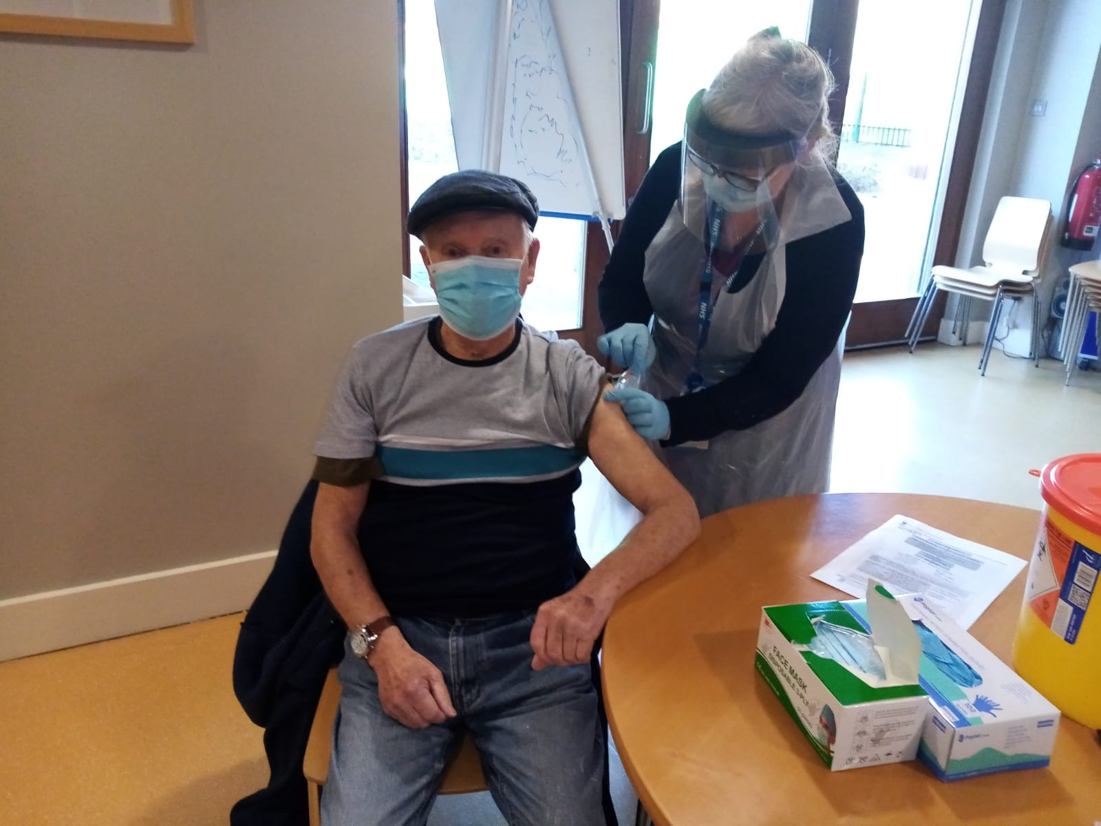 VACCINE: Sam McClenaghan receives his jab from local healthcare nurse Roberta