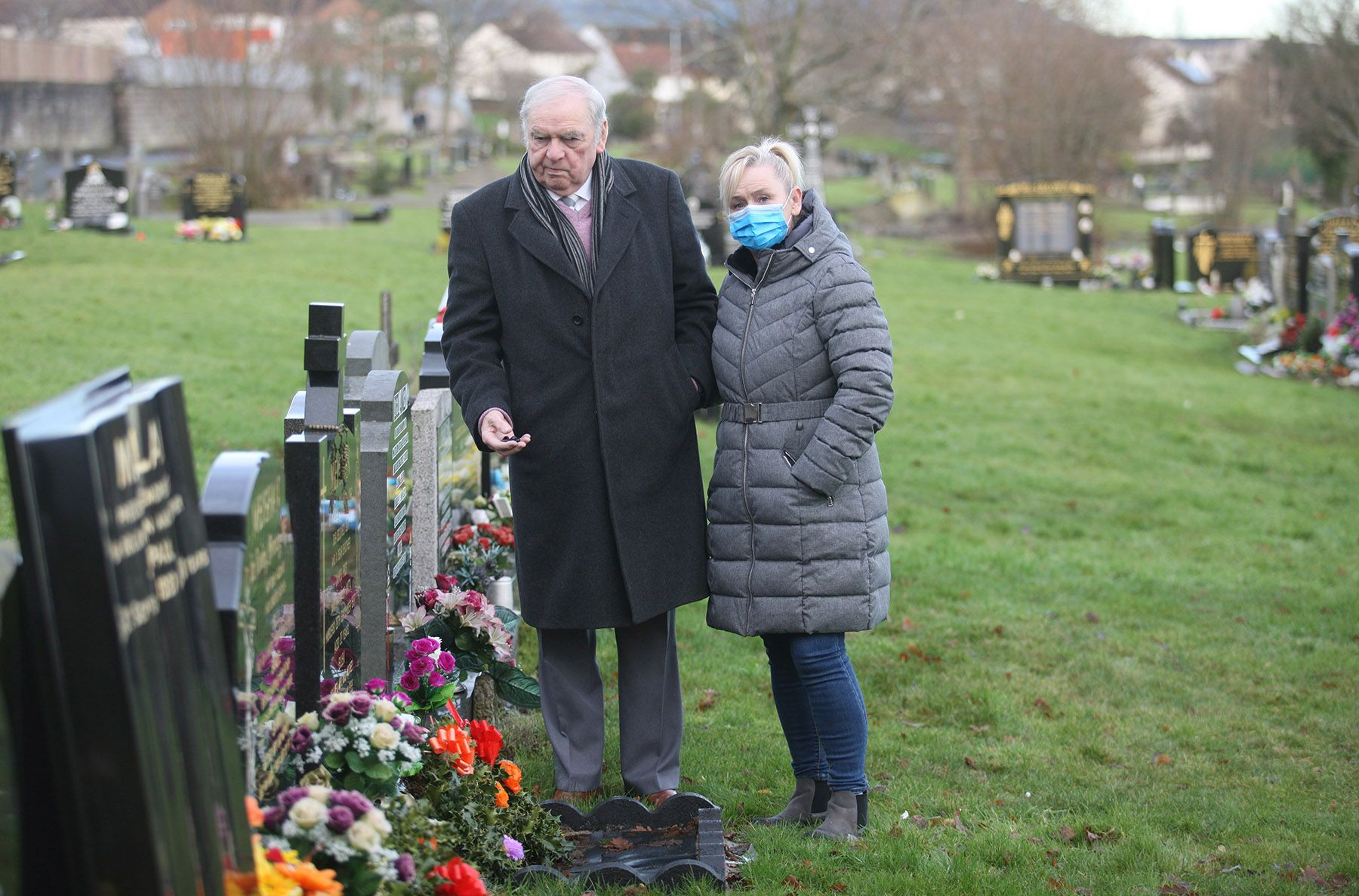 DISTRAUGHT: Michelle Meighan with her father Jim at the family's City Cemetery burial plot