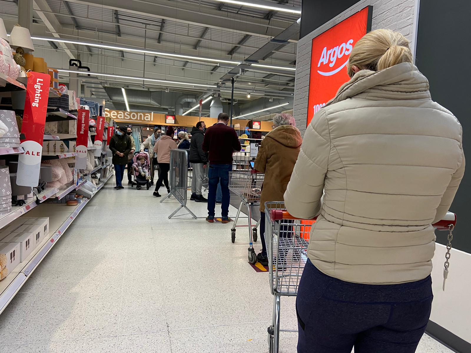 \'SELFISH SAINSBURY\'S\': Customers queue for the click-and-collect service at Argos in Sainsbury\'s Andersonstown while locally-owned stores selling household items are forbidden to do business - including click-and-collect