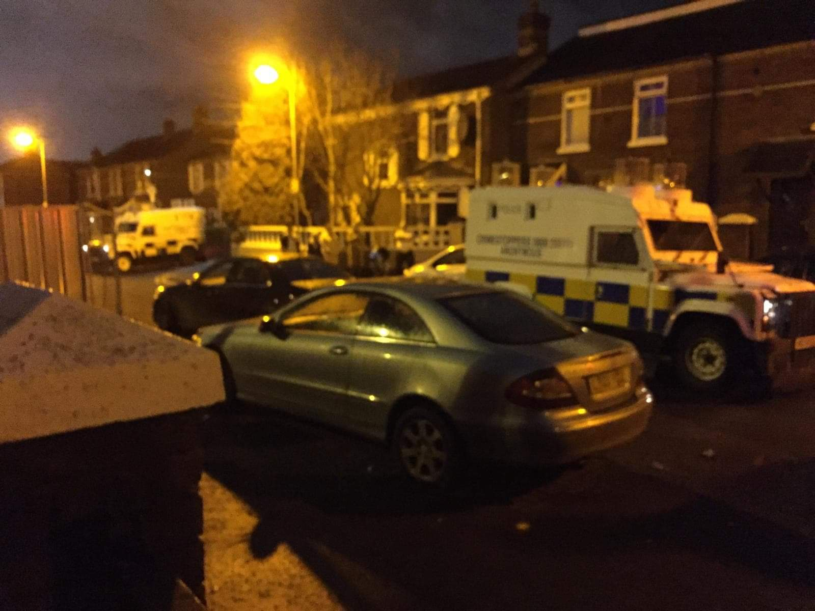 QUESTIONS: Police Land Rovers at the wake house on Cullingtree Road