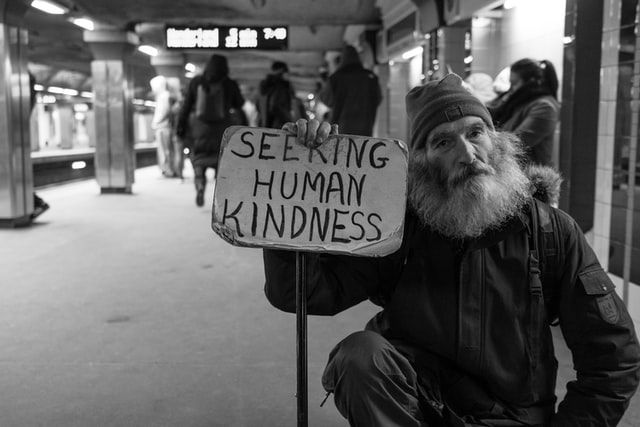 COMPASSION FOR OTHERS: Michael with a message in a Boston subway station