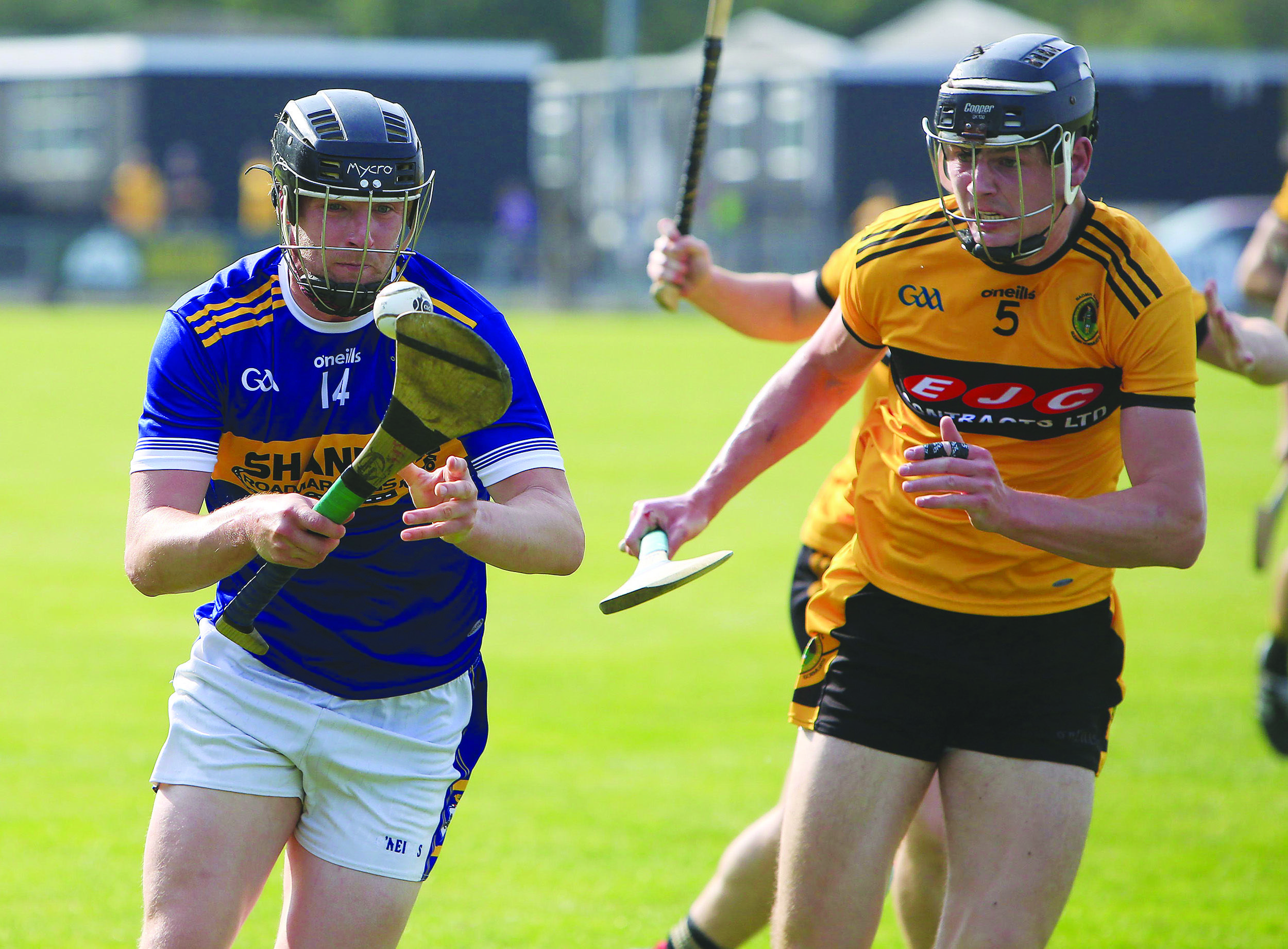 Stephen Beatty in action with Joe Maskey during the group game between Rossa and Naomh Éanna in August