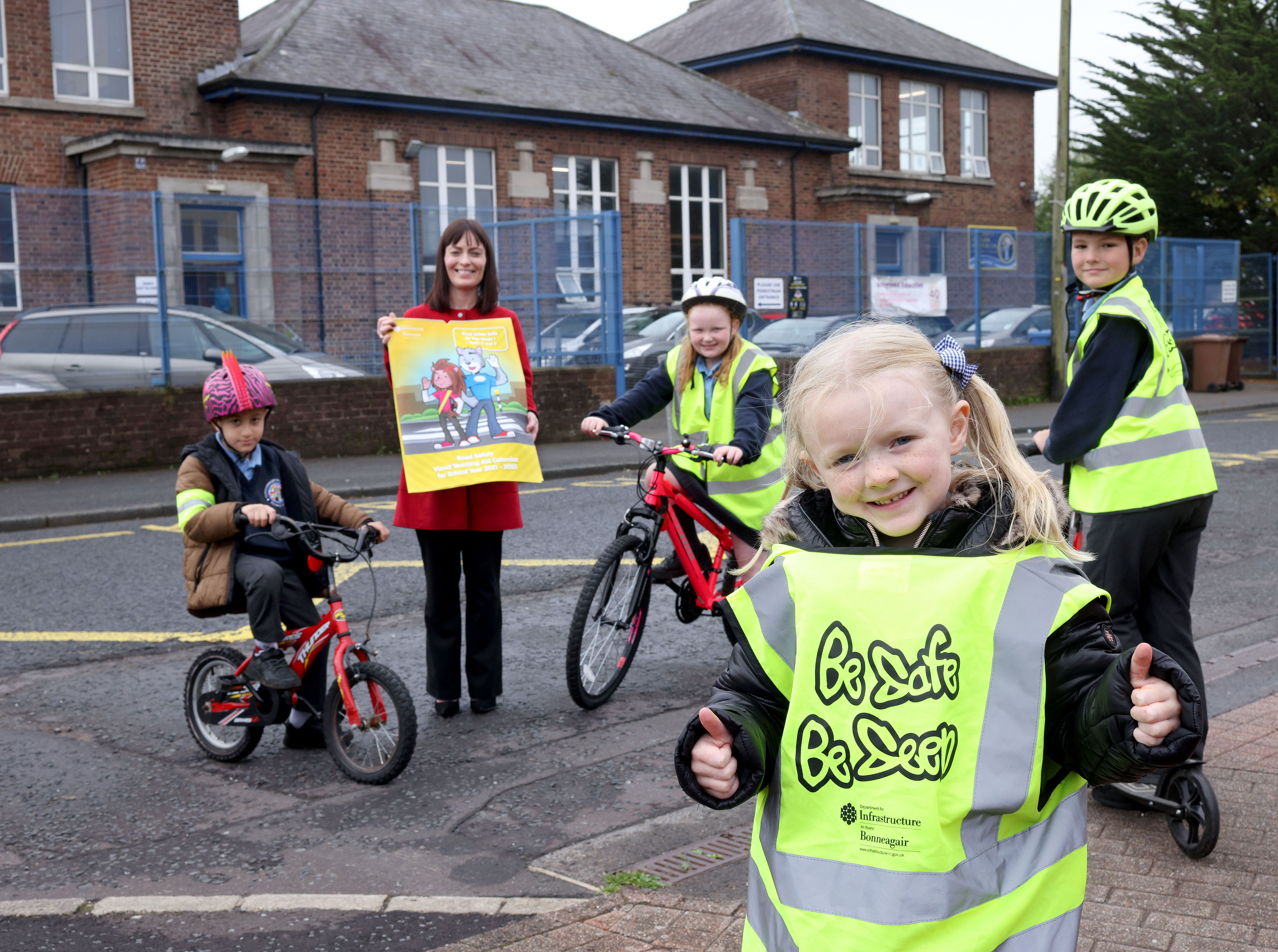 BE SAFE AND SEEN: Infrastructure Minister Nichola Mallon with Glengormley Integrated Primary School pupils Milad Al-Shbeeb, Lexi Fenton, Murran Denvir and Emil Staniszewski
