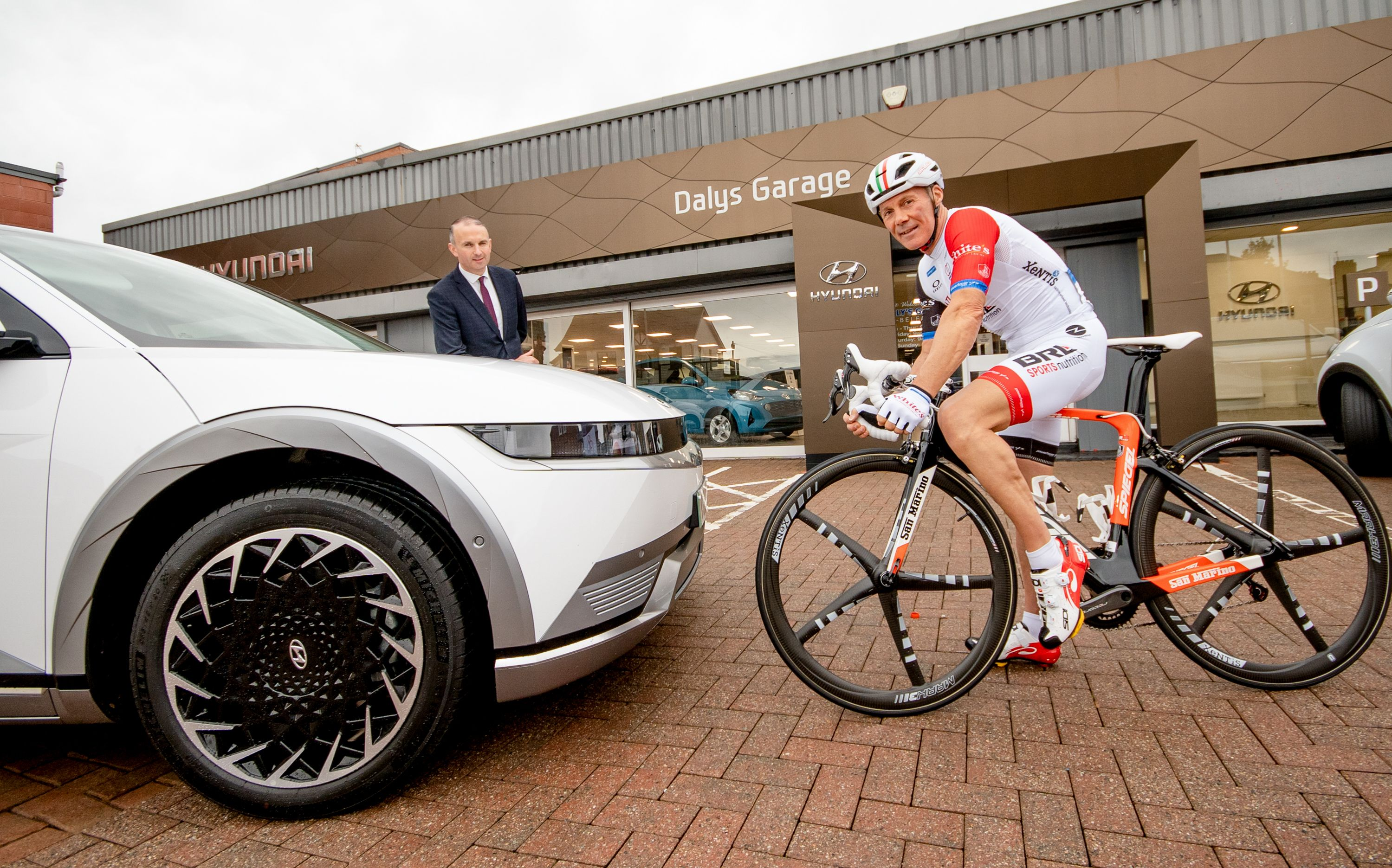 Endurance cyclist, Joe Barr pictured with Daniel Daly, of Daly's Garage