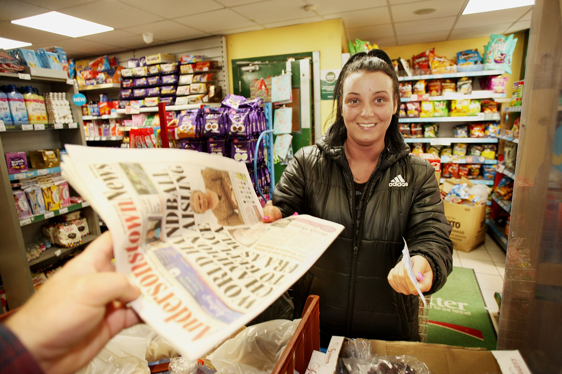 HEART OF THE COMMUNITY: Stacey Burns picks up this week\'s Andersonstown News at Costcutter\'s in Beechmount
