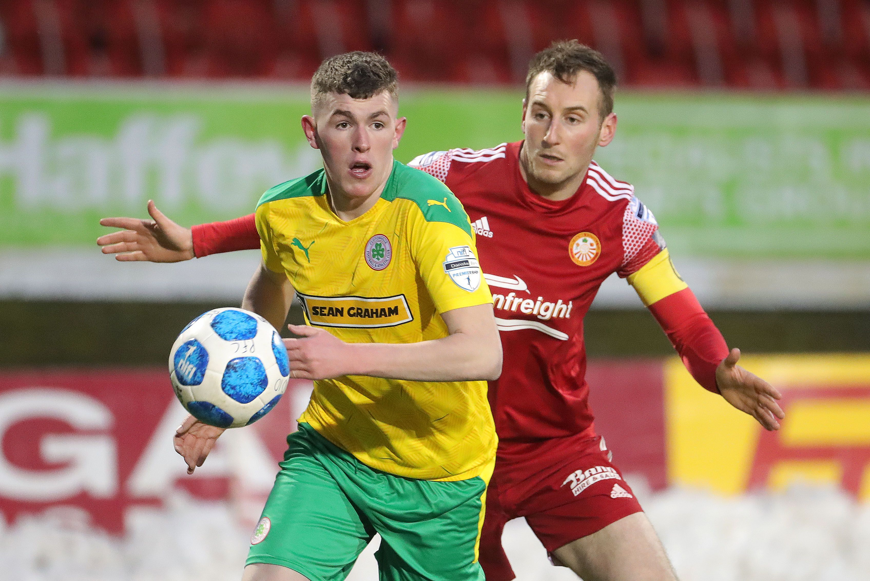 Paul Finnegan of Portadown challenges Aaron Donnelly of Cliftonville on Saturday