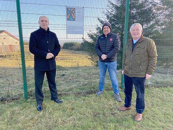 CALLING THE FAITHFUL:Father Kevin McGuckien, Lámh Dhearg Chairman Peter Kane and Jim McCormick, Chairman of the Hannahstown Community Association