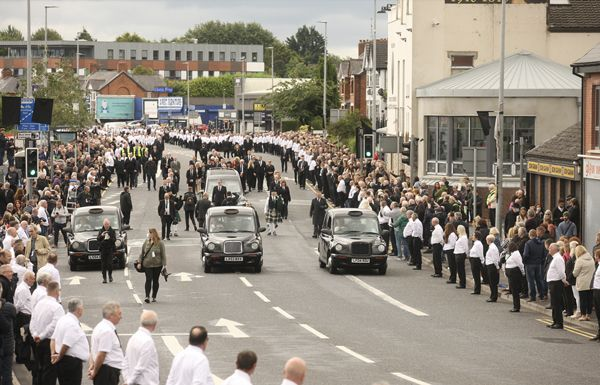 Thousands of republicans lined the streets of West Belfast for the funeral of Bobby Storey