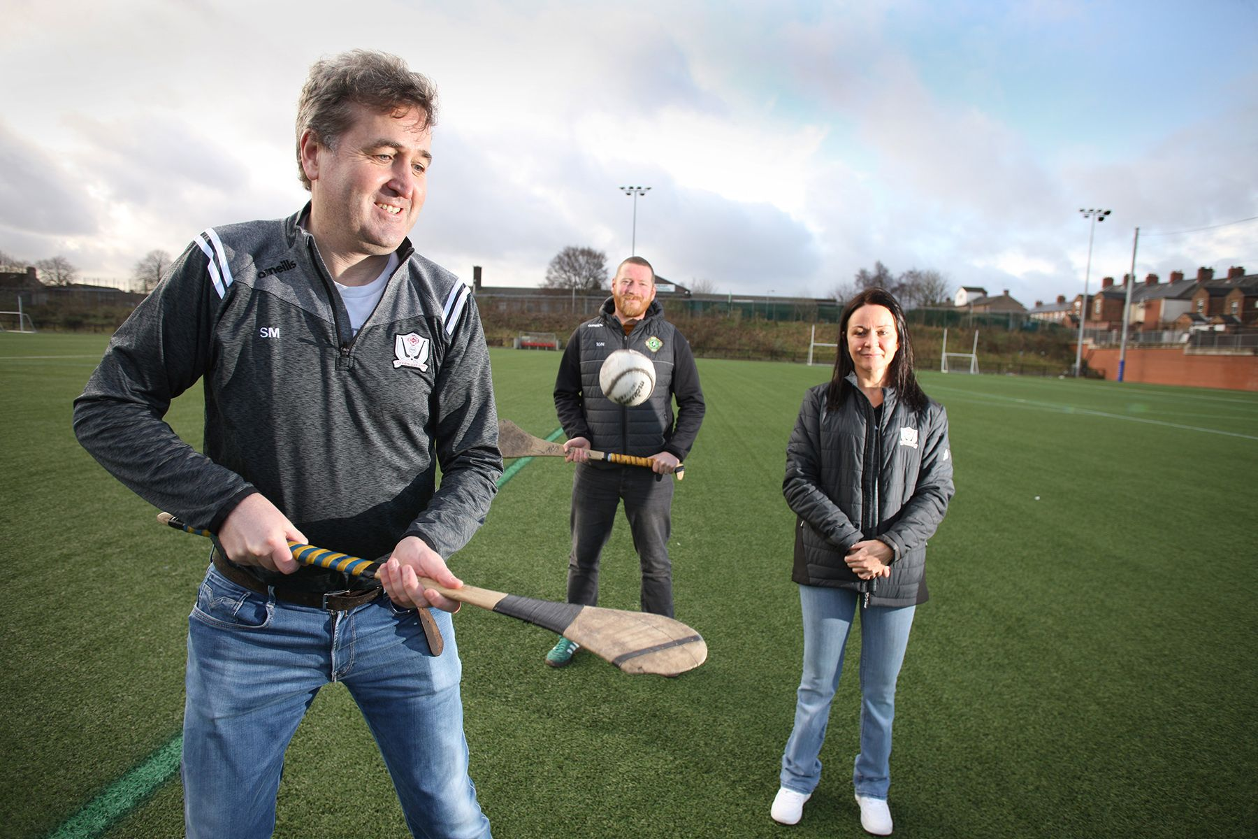 MAITH SIBH: Seán Moyes shows off his hurling skils with Tomás O'Neill and Cllr Nichola Bradley looking on