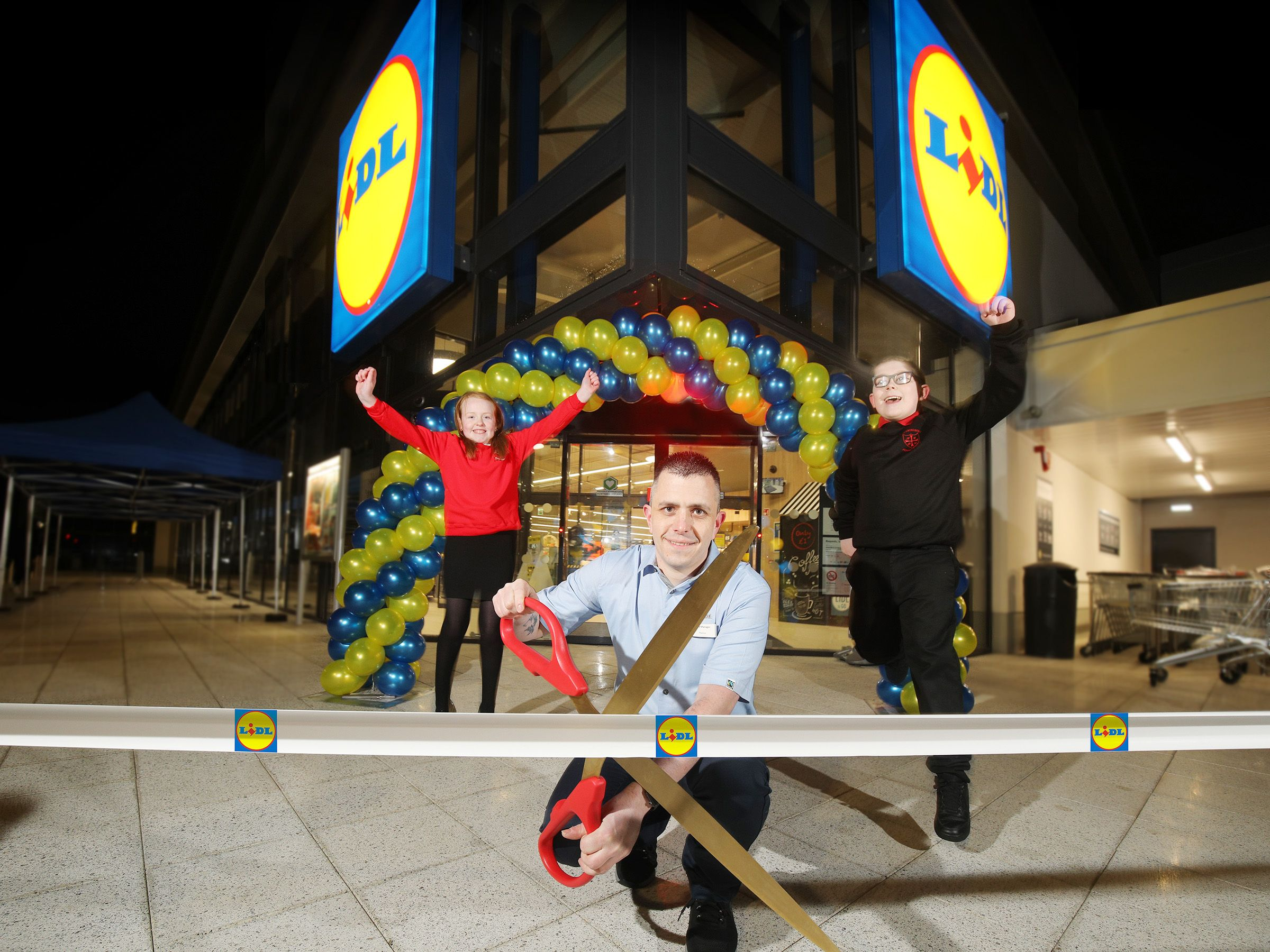 OFFICIAL OPENING: Lily Irvine (Edenbrooke Primary School), Thomas McFarlane (Lidl Northern Ireland Hillview Retail Park Store Manager) and Pearse Osborne (Holy Cross Boys Primary) at the new Lidl store on the Crumlin Road