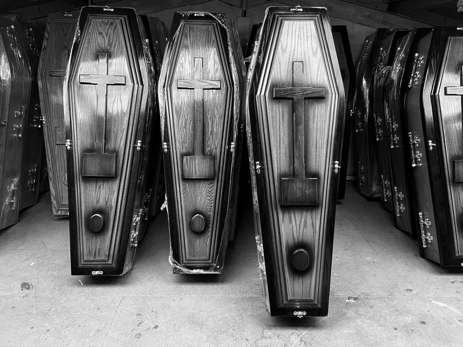 COVID CRISIS: Let\'s be guided by data not by dates. Coffins being stored in a Belfast funeral parlour.