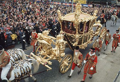 FABULOUS WEALTH: From her golden coach Queen Elizabeth urges us to think about other people