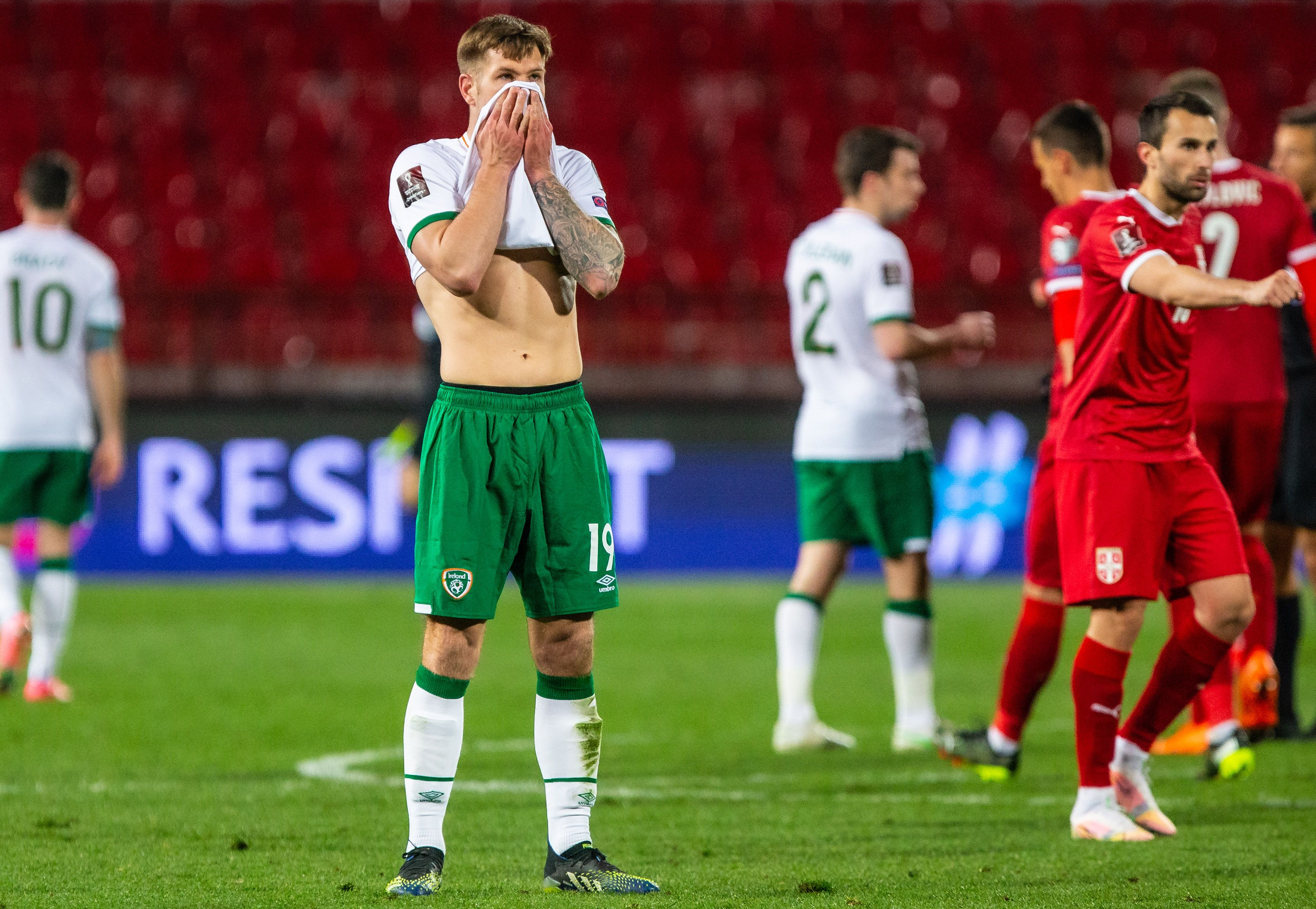 Ireland\'s James Collins dejected after the 3-2 defeat to Serbia