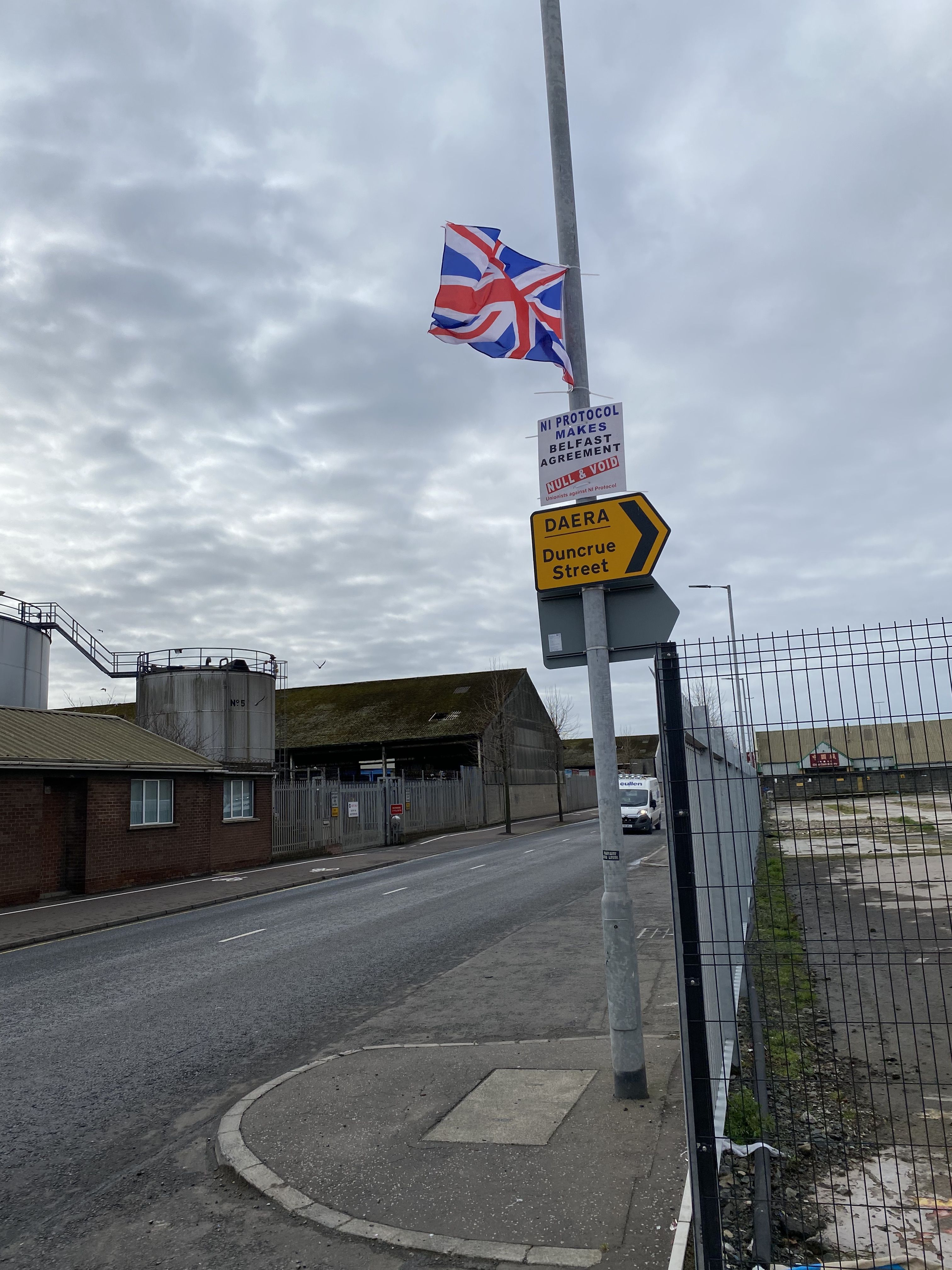 """WESTMINSTER REMOTE FROM REGIONS\"": Union flags and slogans erected at the new Customs depot at Duncrue Street in the Dock to check goods arriving from Britain into the EU Single Market"