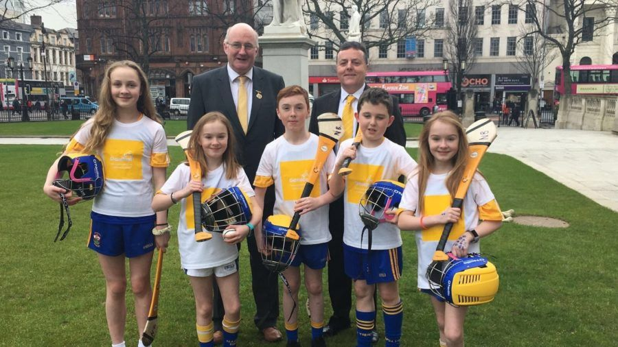 Former GAA President John Horan, ex-Antrim Chairman Collie Donnelly and young members of St Brigid\'s at the Gaelfast launch back in 2018