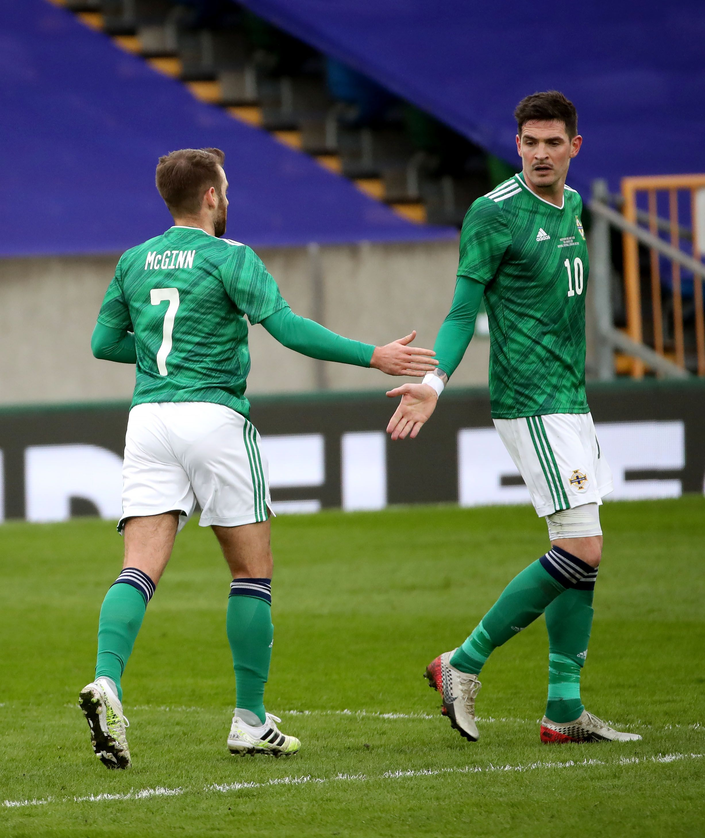 CONSOLATION: Kyle Lafferty congratulates Niall McGinn whose late goal was not enough to prevent a friendly defeat to USA in Belfast (Credit: Press Eye)
