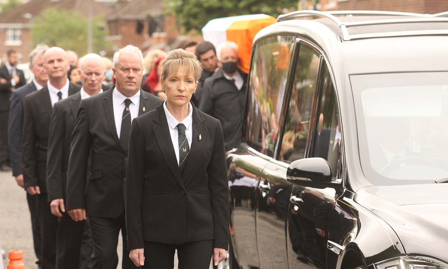 MELTDOWN, AGAIN: The Bobby Storey funeral cortege makes its way through West Belfast