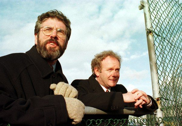 WAY WE WERE: Then Sinn Féin President Gerry Adams and Martin McGuinness look over the wire in Stormont Castle at lunch time after putting their final approval to the Good Friday Agreement on 10 April 1998.