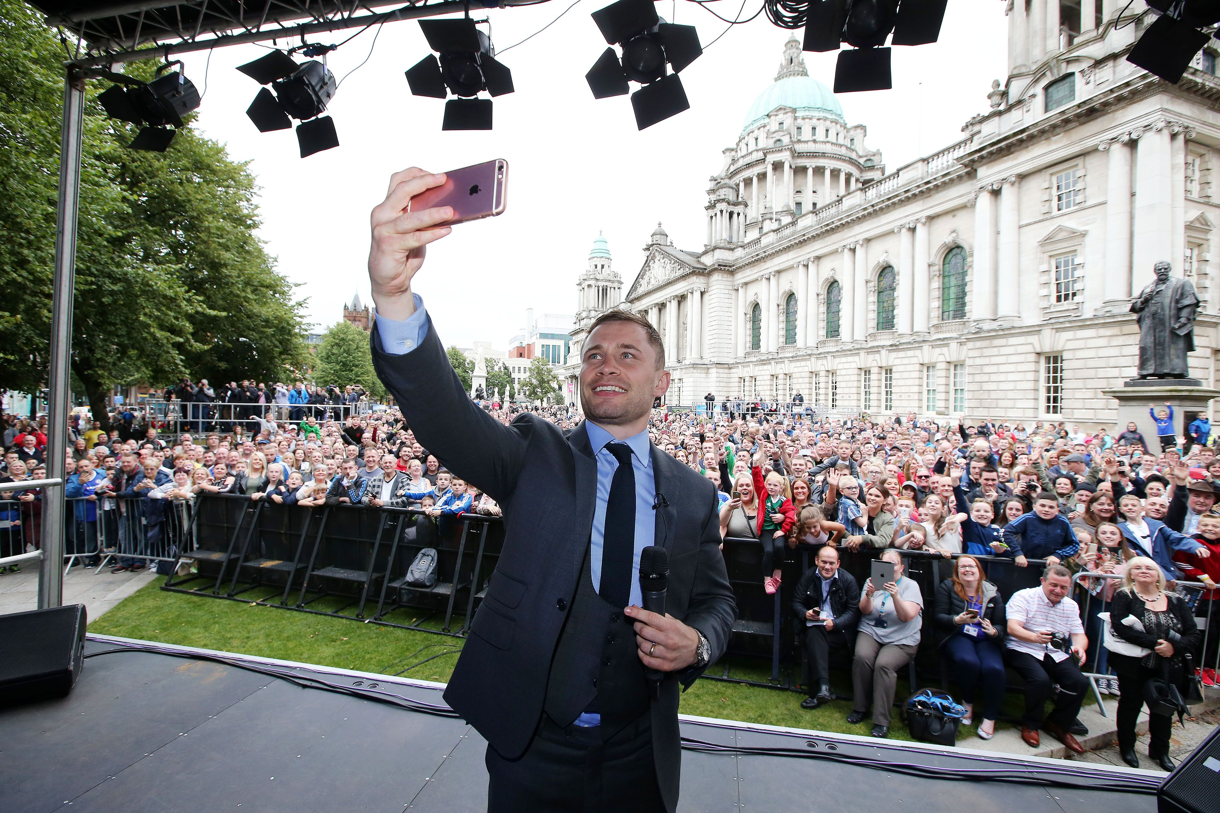 Carl Frampton takes a selfie with fans during a civic reception at Belfast\'s City Hall following his 2016 win over Leo Santa Cruz when he claimed the WBA featherweight title