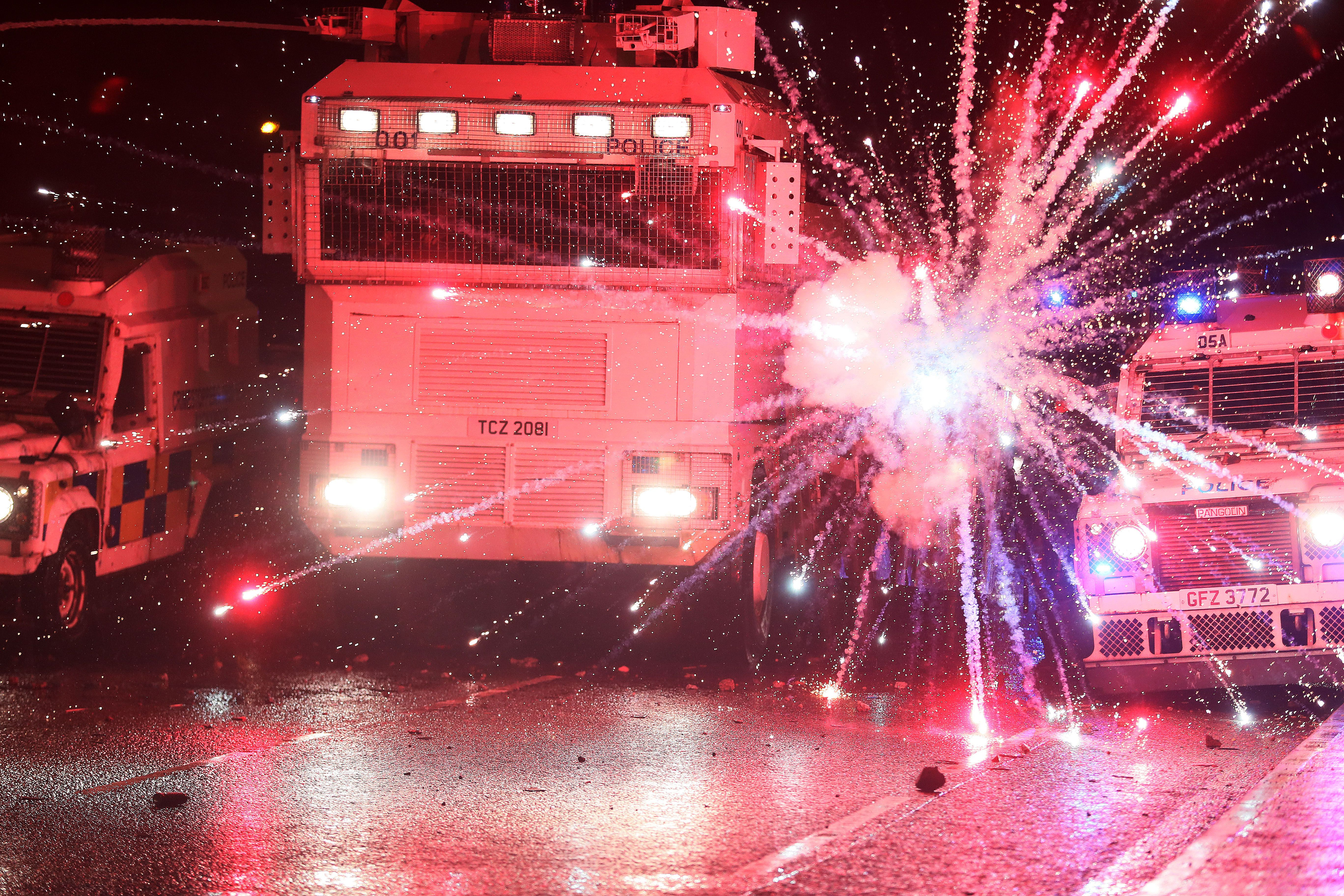 MISSILE: A firework is thrown at police during a second night of disturbances on the Springfield Road